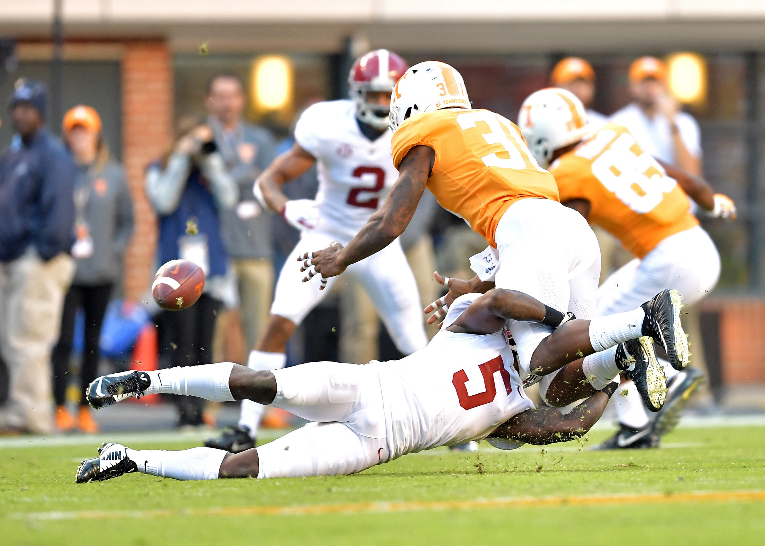 Alabama Crimson Tide defensive back Shyheim Carter (5) forces a fumble while tackling Tennessee Volunteers running back Madre London (31) in the second half of the NCAA football game on Saturday, Oct. 20, 2018, at Neyland Stadium in Knoxville. Tenn. Alabama wins 58-21. (Photo by Lee Walls)