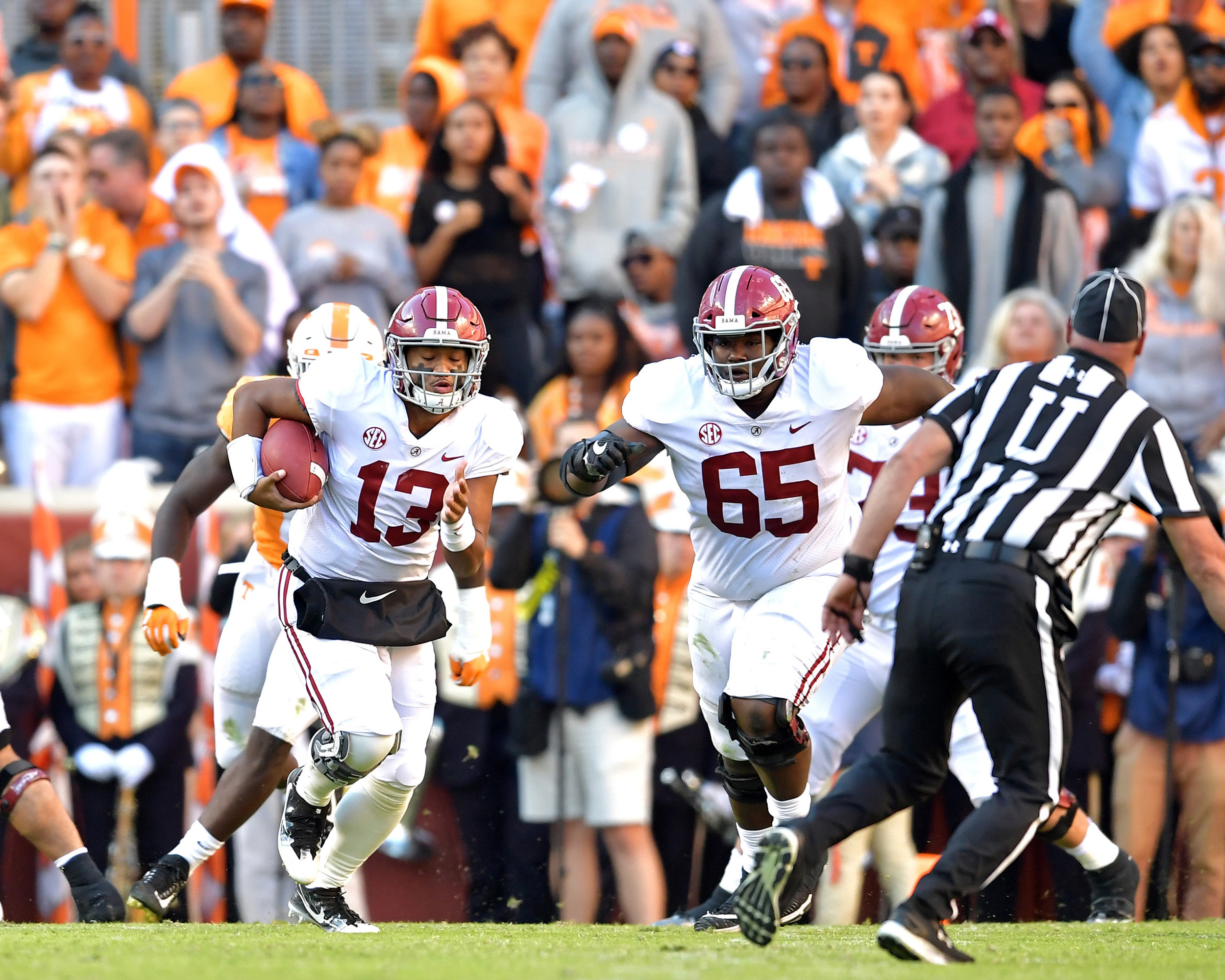 Alabama Crimson Tide quarterback Tua Tagovailoa (13) with a keeper in the second quarter of the Alabama at Tennessee NCAA football game on Saturday, Oct. 20, 2018, at Neyland Stadium in Knoxville. Tenn. Alabama wins 58-21. (Photo by Lee Walls)