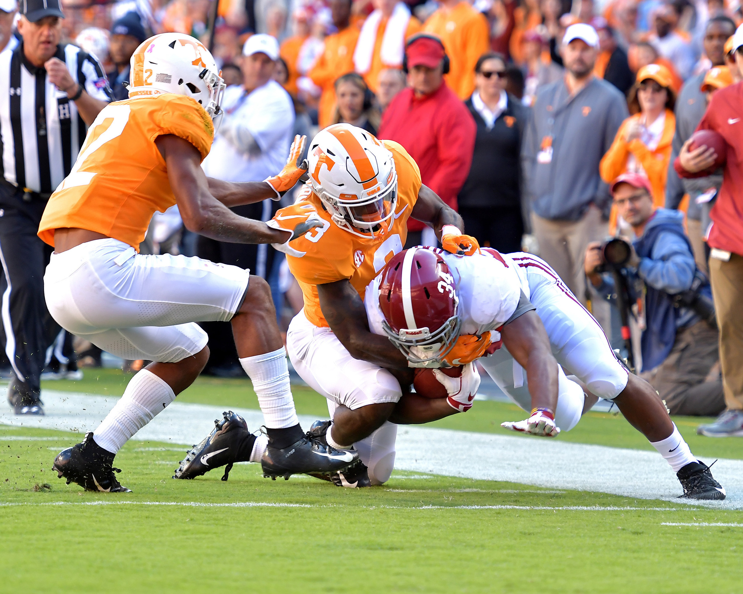 Alabama Crimson Tide running back Damien Harris (34) is tackled after a catch and a first down during first half of the Alabama at Tennessee NCAA football game on Saturday, Oct. 20, 2018, at Neyland Stadium in Knoxville. Tenn. Alabama wins 58-21. (Photo by Lee Walls)