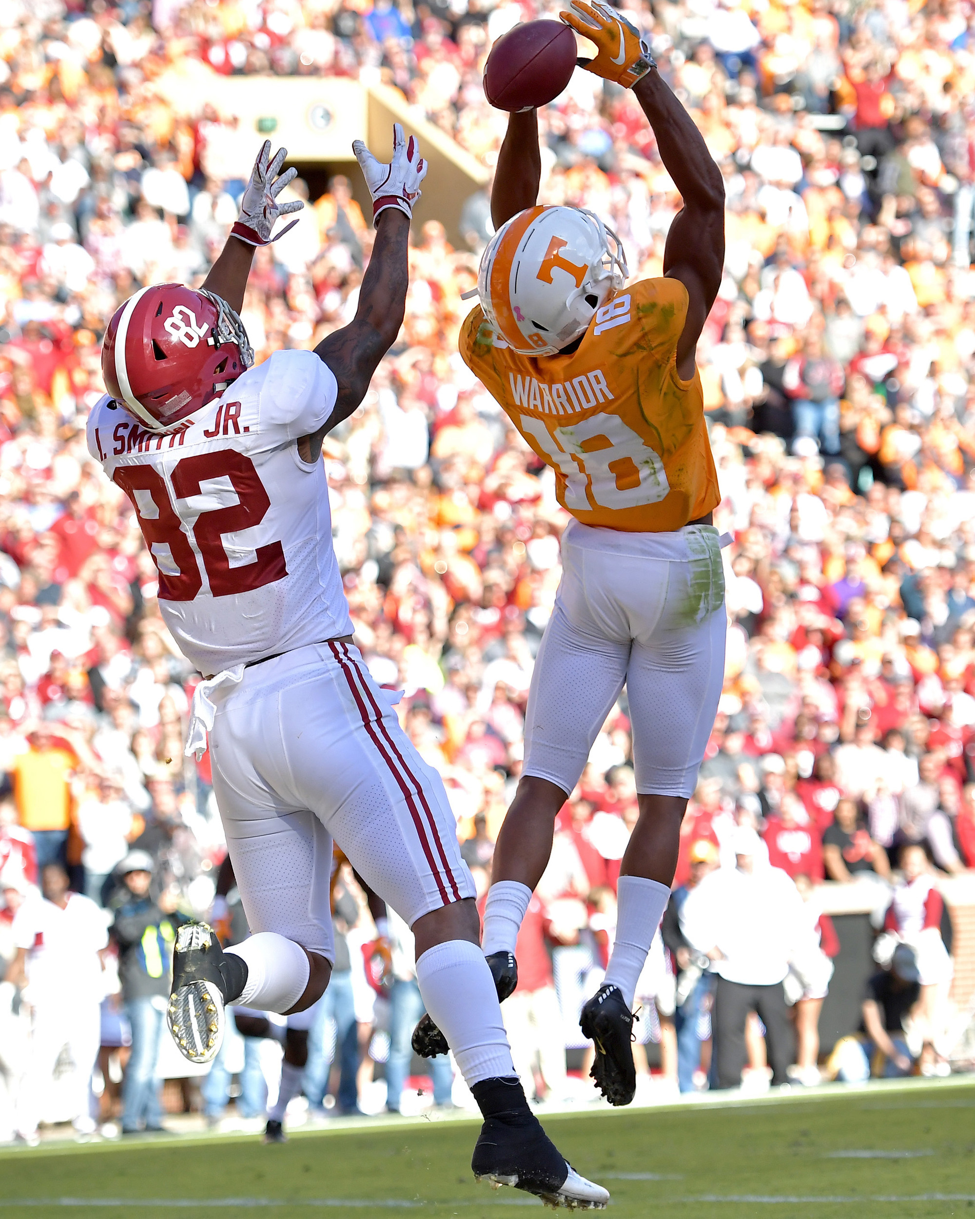 Tennessee Volunteers defensive back Nigel Warrior (18) comes close to intercepting a pass intended for Alabama Crimson Tide tight end Irv Smith Jr. (82) in the first half of the NCAA football game on Saturday, Oct. 20, 2018, at Neyland Stadium in Knoxville. Tenn. Alabama wins 58-21. (Photo by Lee Walls)