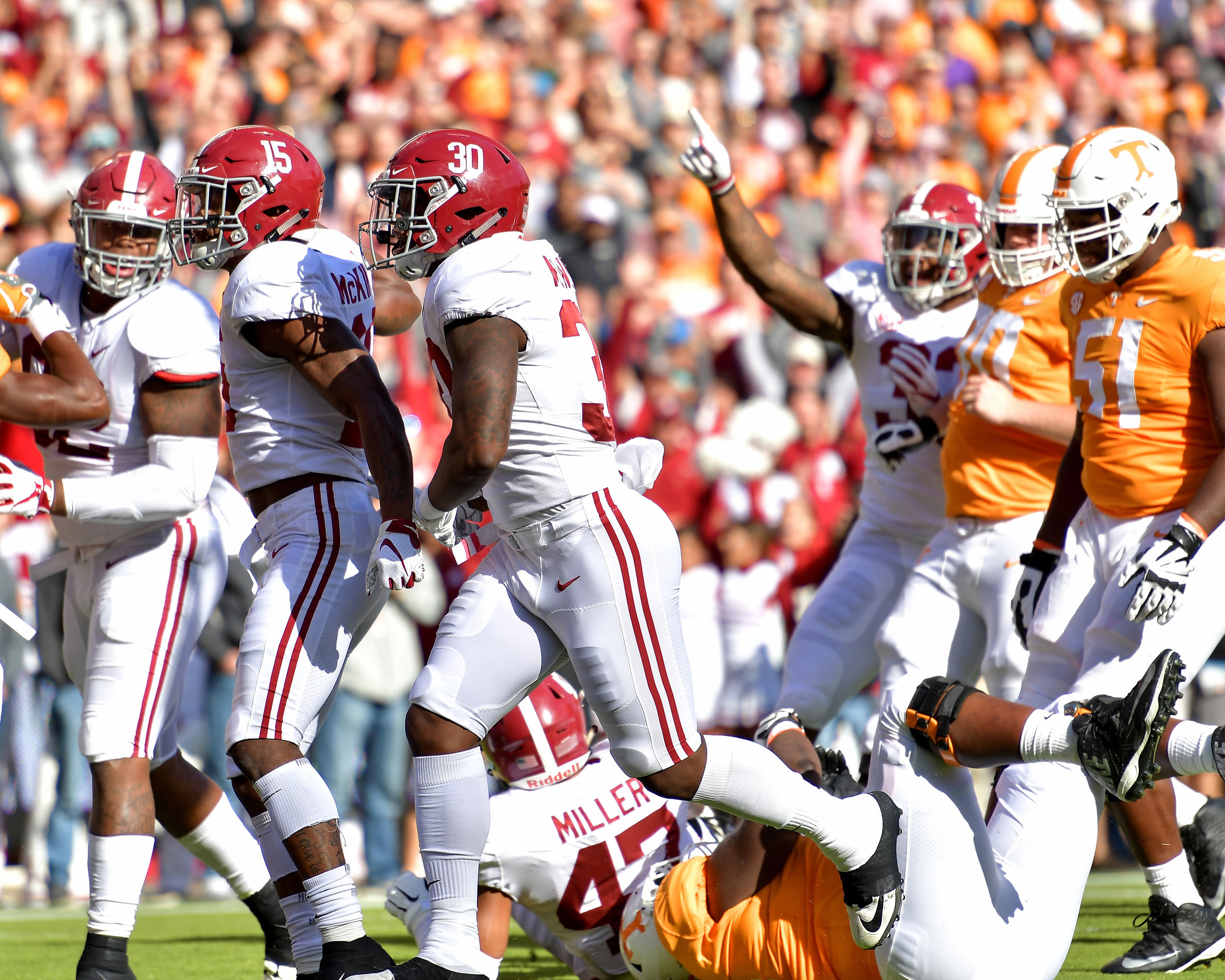 Alabama Crimson Tide linebacker Mack Wilson (30) and defensive back Xavier McKinney (15) celebrate a sack of Tennessee Volunteers quarterback Jarrett Guarantano (2) in the first quarter of the NCAA football game on Saturday, Oct. 20, 2018, at Neyland Stadium in Knoxville. Tenn. Alabama wins 58-21. (Photo by Lee Walls)