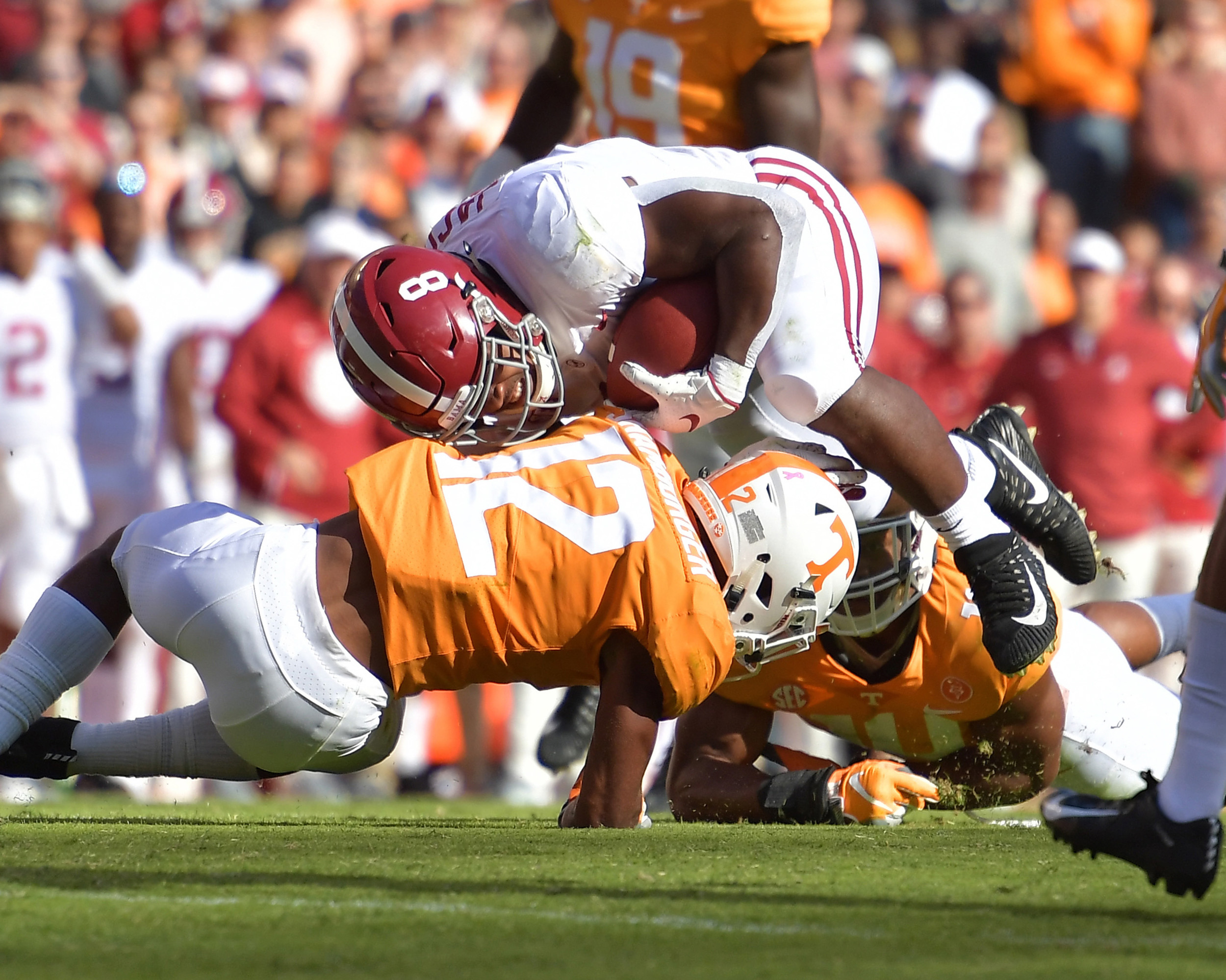 Alabama Crimson Tide running back Josh Jacobs (8) is tackled by Tennessee Volunteers defensive back Shawn Shamburger (12) in the first quarter of the NCAA football game on Saturday, Oct. 20, 2018, at Neyland Stadium in Knoxville. Tenn. Alabama wins 58-21. (Photo by Lee Walls)