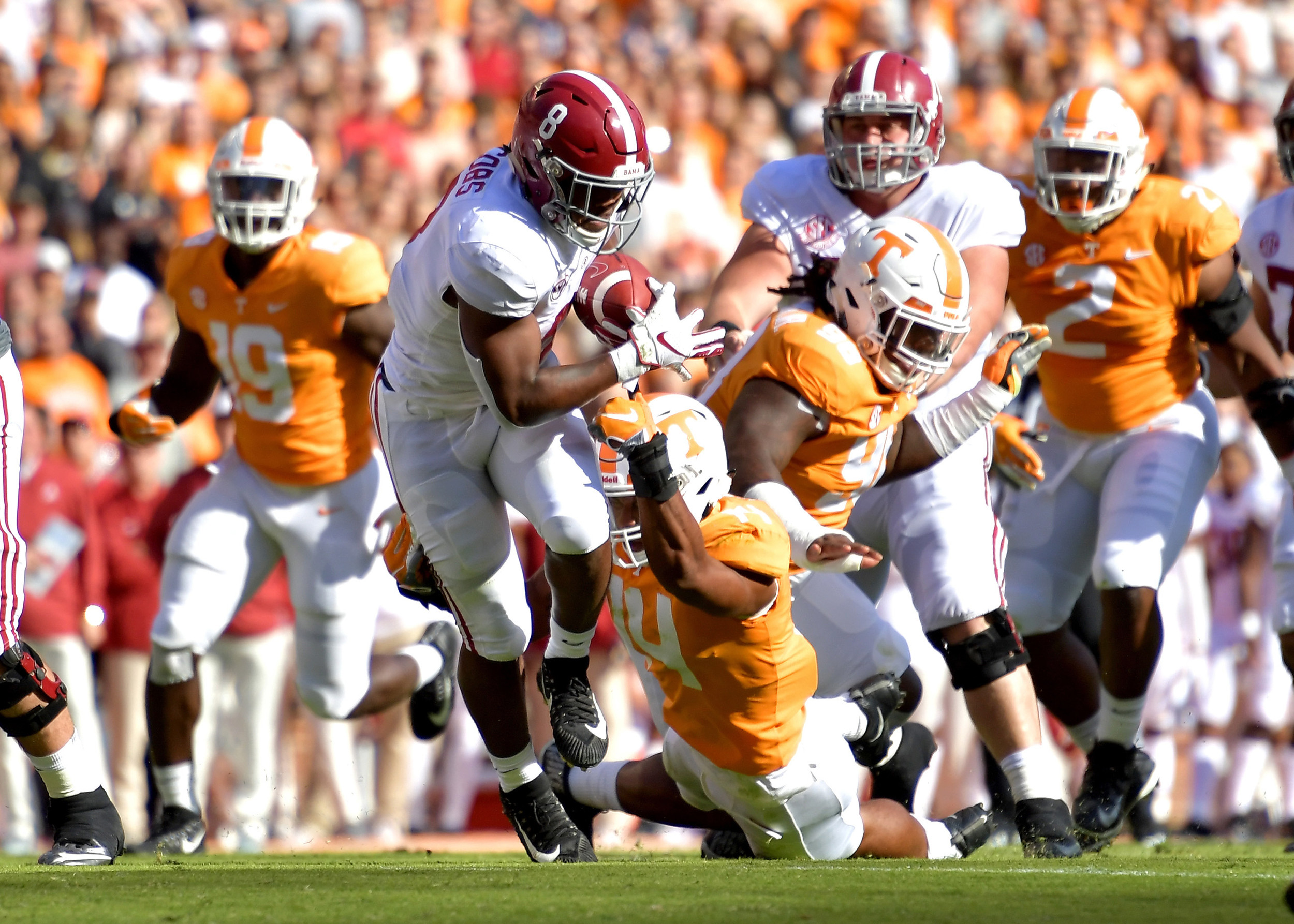 Alabama Crimson Tide running back Josh Jacobs (8) gets past Tennessee Volunteers linebacker Quart'e Sapp (14) in the first quarter of the NCAA football game on Saturday, Oct. 20, 2018, at Neyland Stadium in Knoxville. Tenn. Alabama wins 58-21. (Photo by Lee Walls)