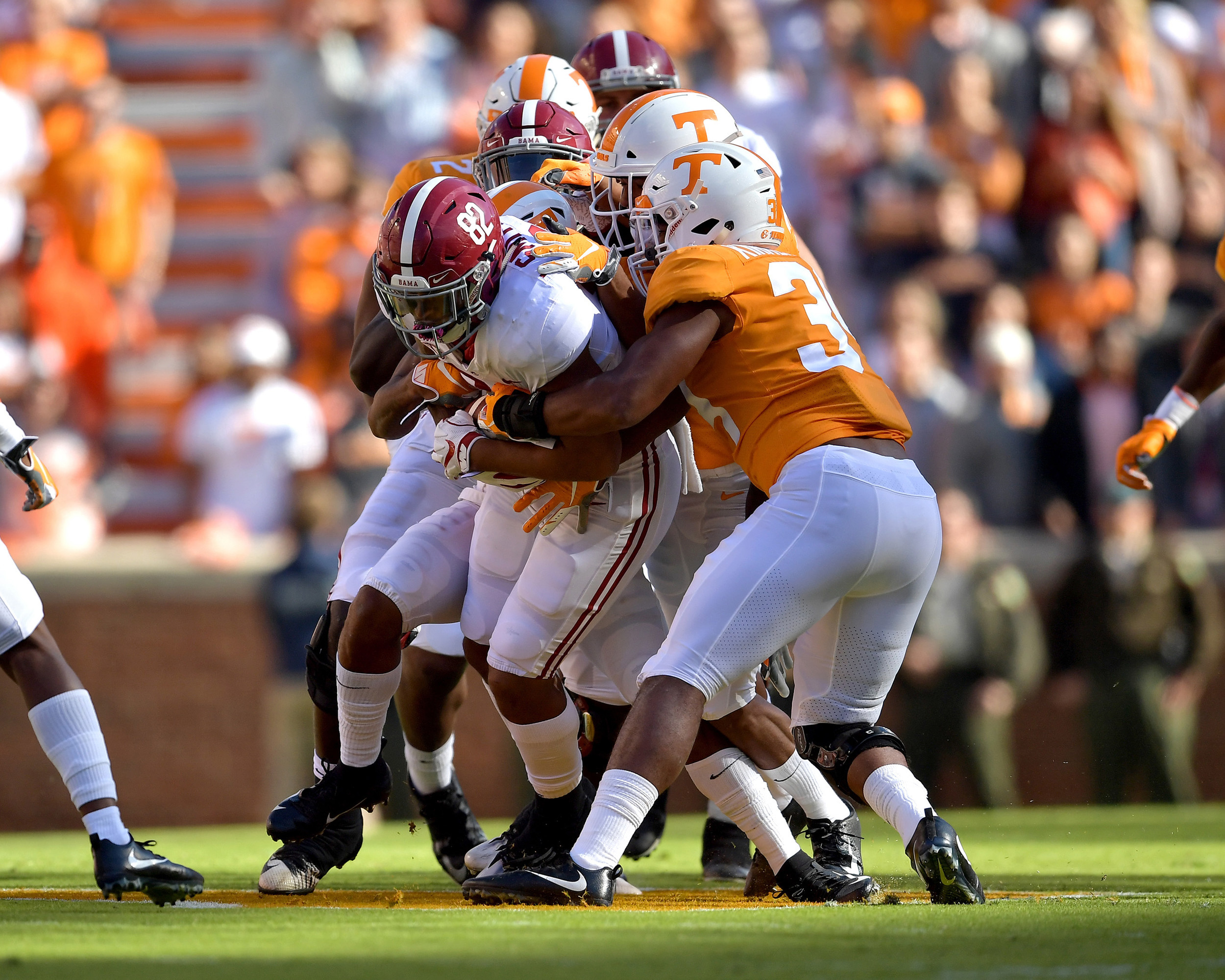 Alabama Crimson Tide tight end Irv Smith Jr. (82) works his way through the Tennessee Volunteers during the first half of the NCAA football game on Saturday, Oct. 20, 2018, at Neyland Stadium in Knoxville. Tenn. Alabama wins 58-21. (Photo by Lee Walls)