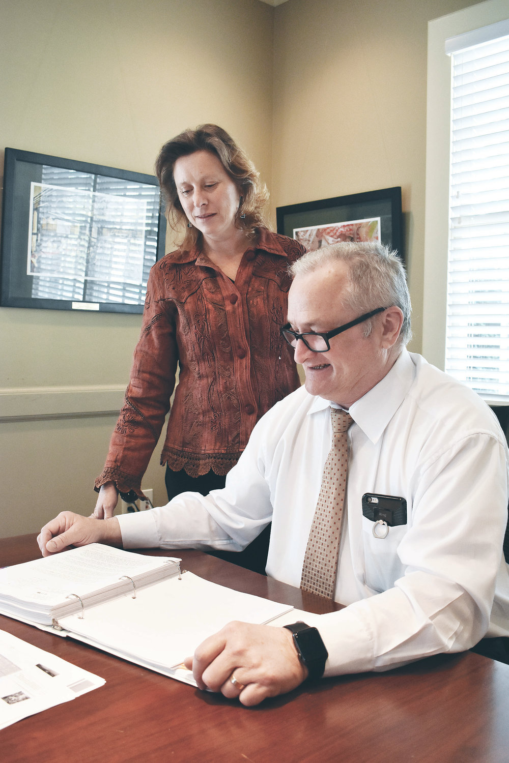 Kellie Johnston, left, executive director of Cawaco Resource Conservation & Development (RC&D) Council, Inc., and Paul Kennedy, a member of Cawaco's board of directors, look over plans in Jasper Monday. The organization has announced its grants for Fiscal 2019.