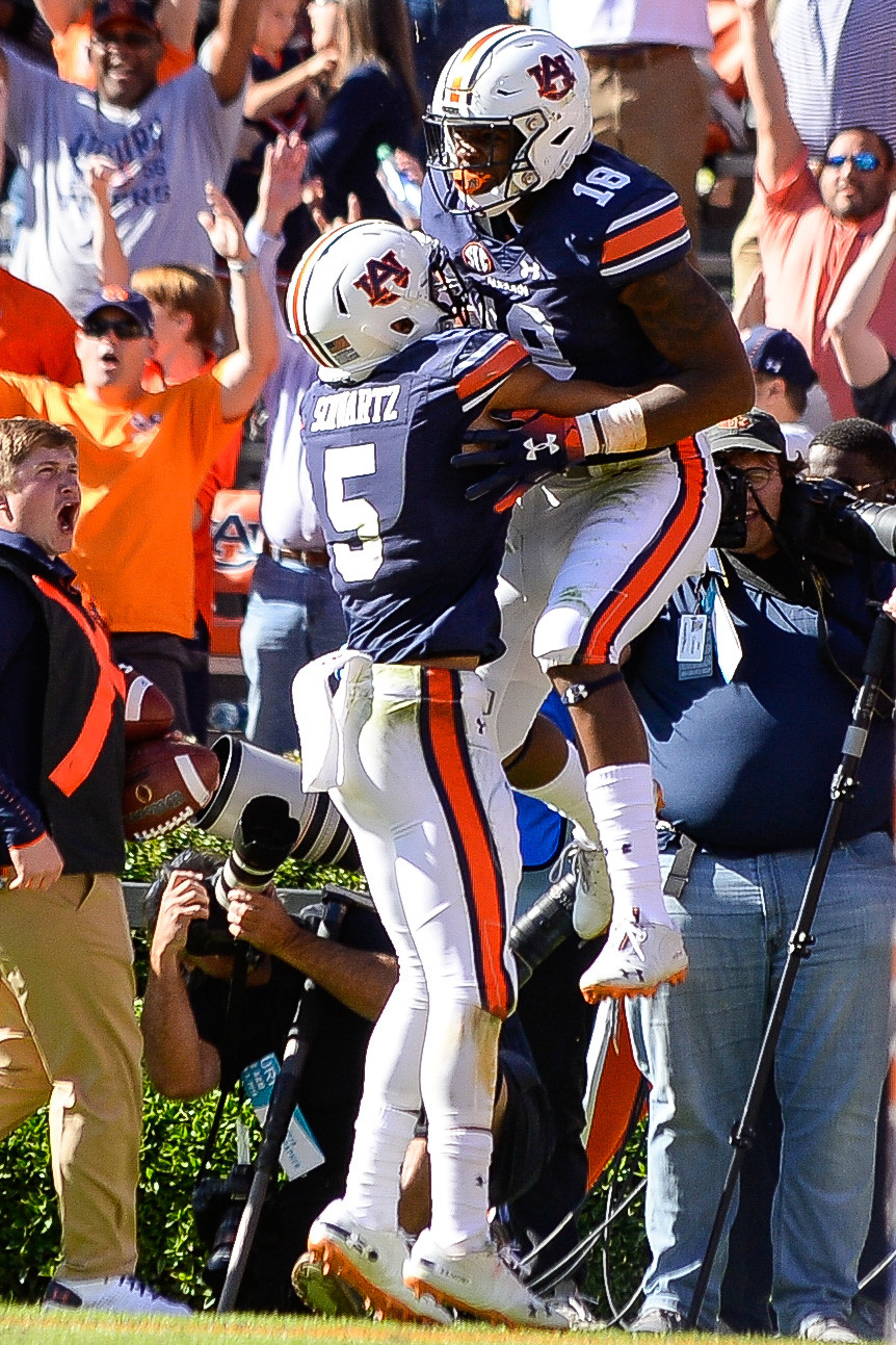 Auburn Tigers wide receivers Anthony Schwartz (5) and  Seth Williams (18) celebrate a touchdown during the second half of an NCAA football game against the Texas A&M Aggies Saturday, November 3, 2018, at Jordan-Hare Stadium in Auburn, Ala. (Photo by Jeff Johnsey)
