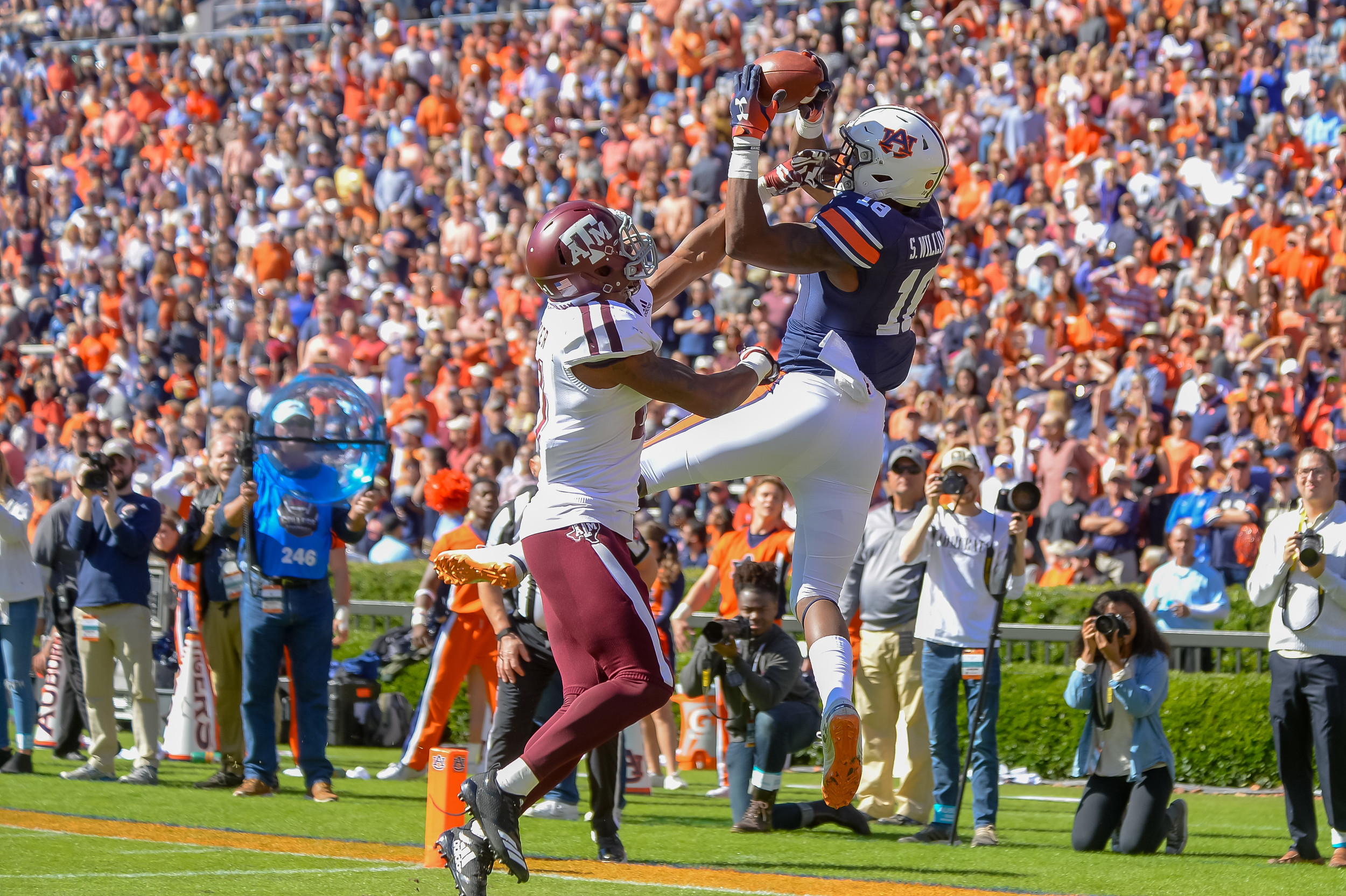 Auburn Tigers wide receiver Seth Williams (18) makes a catch above Texas A&M Aggies defensive back Charles Oliver (21) to make a catch during the first half of an NCAA football game against the Texas A&M Aggies Saturday, November 3, 2018, at Jordan-Hare Stadium in Auburn, Ala. (Photo by Jeff Johnsey)