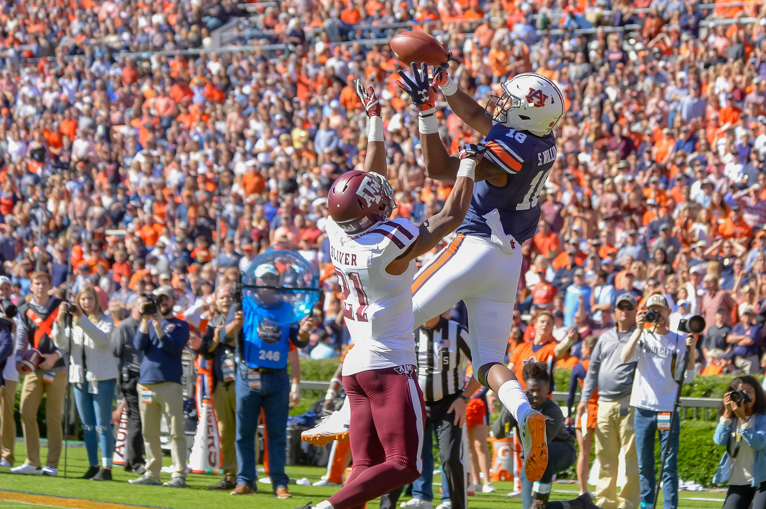 Auburn Tigers wide receiver Seth Williams (18) goes high above Texas A&M Aggies defensive back Charles Oliver (21) to make a catch during the first half of an NCAA football game against the Texas A&M Aggies Saturday, November 3, 2018, at Jordan-Hare Stadium in Auburn, Ala. (Photo by Jeff Johnsey)