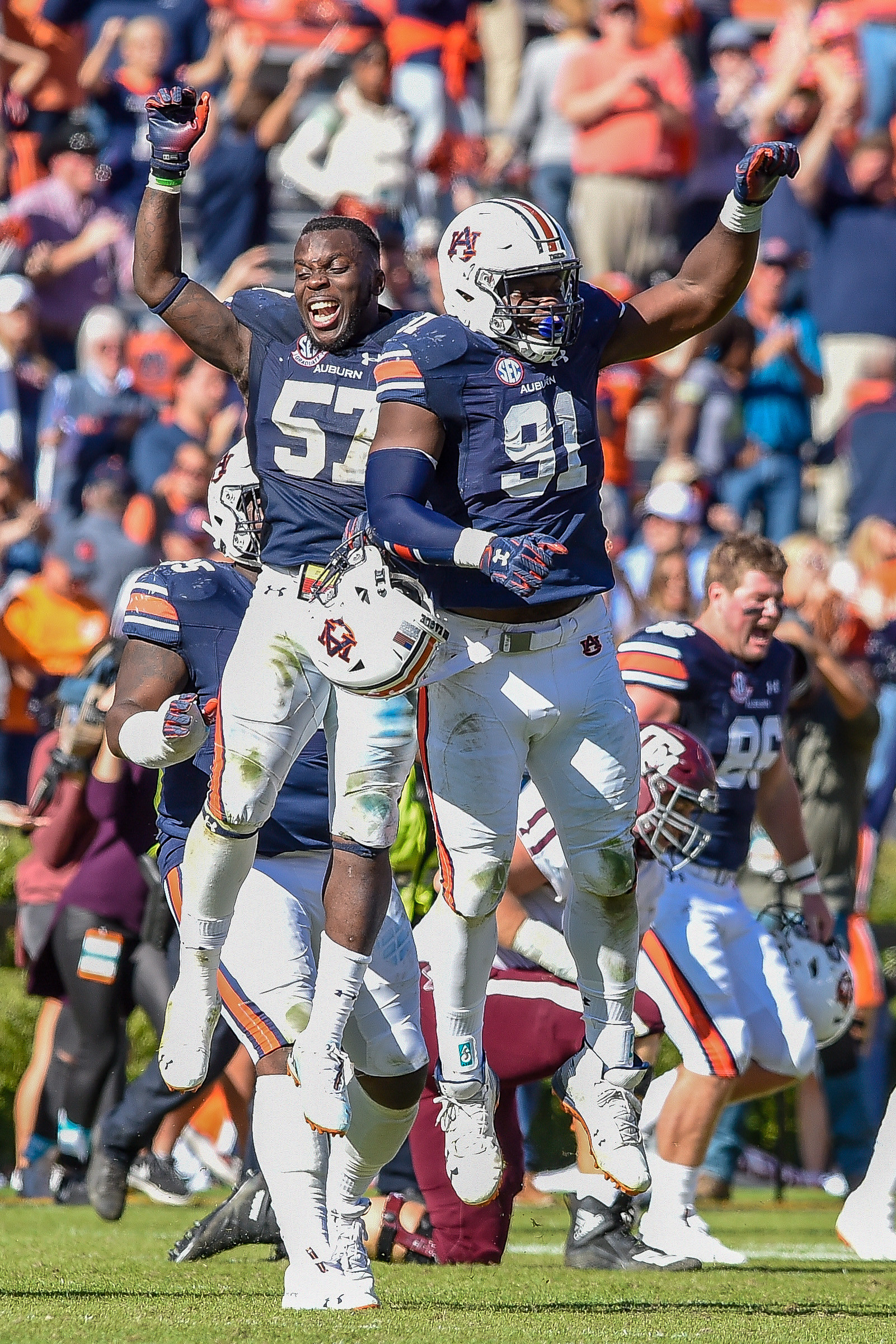 Auburn Tigers linebacker Deshaun Davis (57) and defensive lineman Nick Coe (91) celebrate after time expires of an NCAA football game against the Texas A&M Aggies Saturday, November 3, 2018, at Jordan-Hare Stadium in Auburn, Ala. (Photo by Jeff Johnsey)