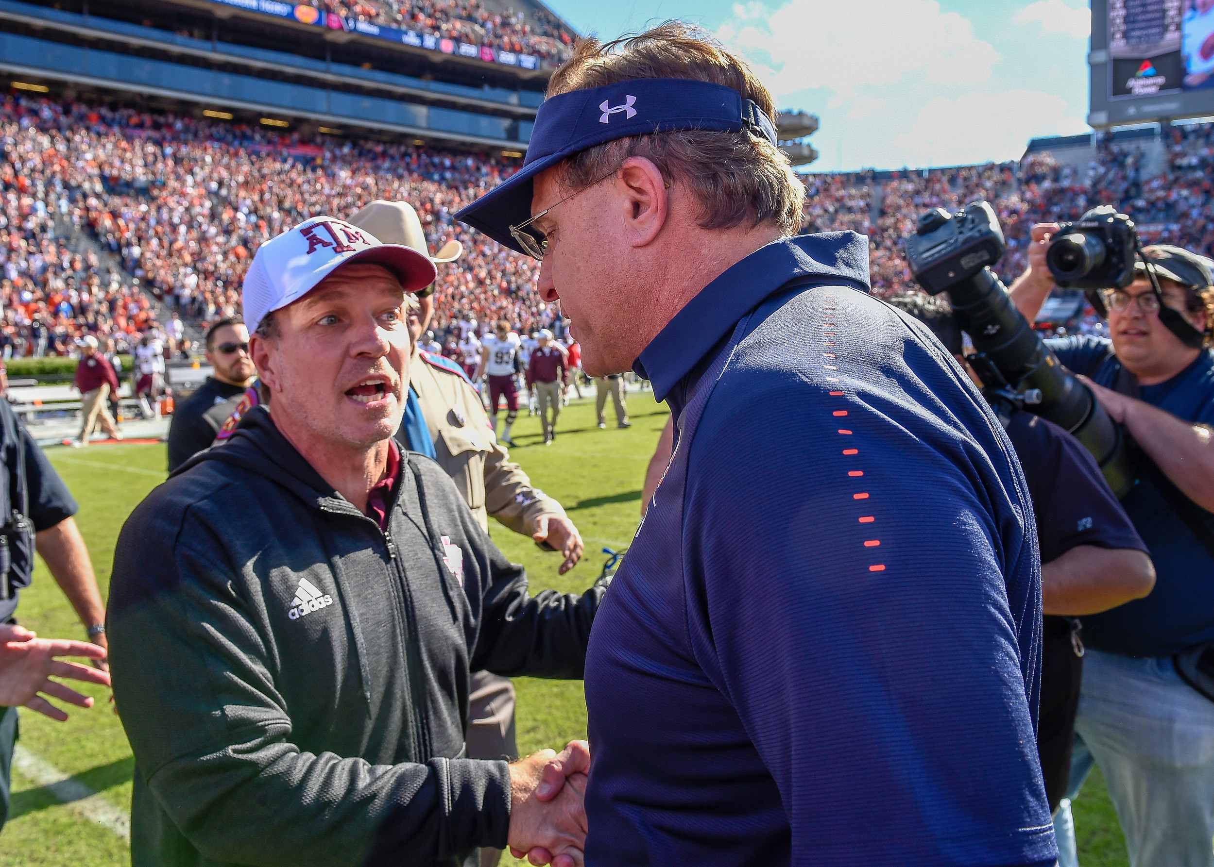 Texas A&M Aggies head coach Jimbo Fisher and Auburn Tigers head coach Gus Malzahn shake hands after an NCAA football game Saturday, November 3, 2018, at Jordan-Hare Stadium in Auburn, Ala. (Photo by Jeff Johnsey)