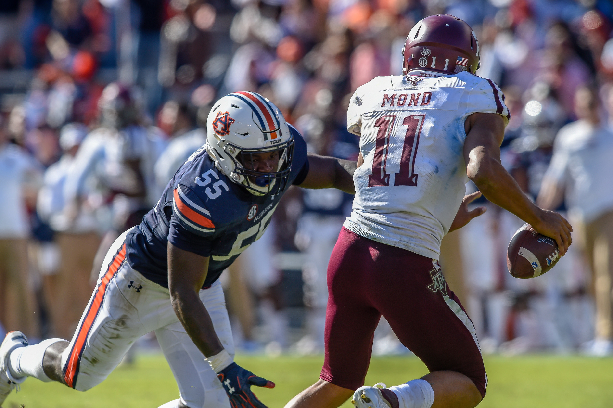 Auburn Tigers linebacker T.D. Moultry (55) pressures Texas A&M Aggies quarterback Kellen Mond (11) during the second half of an NCAA football game Saturday, November 3, 2018, at Jordan-Hare Stadium in Auburn, Ala. (Photo by Jeff Johnsey)