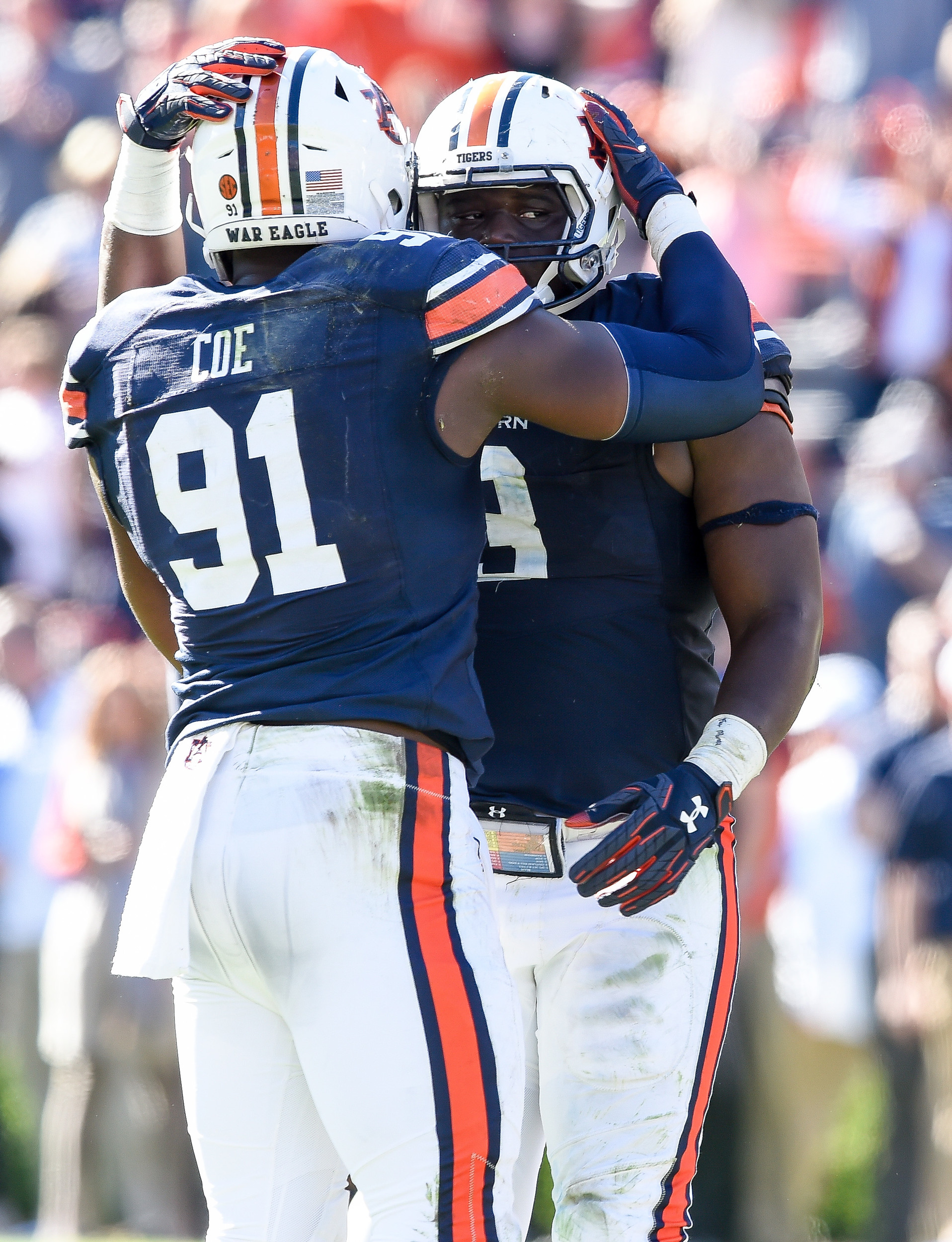 Auburn Tigers defensive lineman Nick Coe (91) and Auburn Tigers defensive lineman Marlon Davidson (3) celebrate as time expires of an NCAA football game against the Texas A&M Aggies Saturday, November 3, 2018, at Jordan-Hare Stadium in Auburn, Ala. (Photo by Jeff Johnsey)