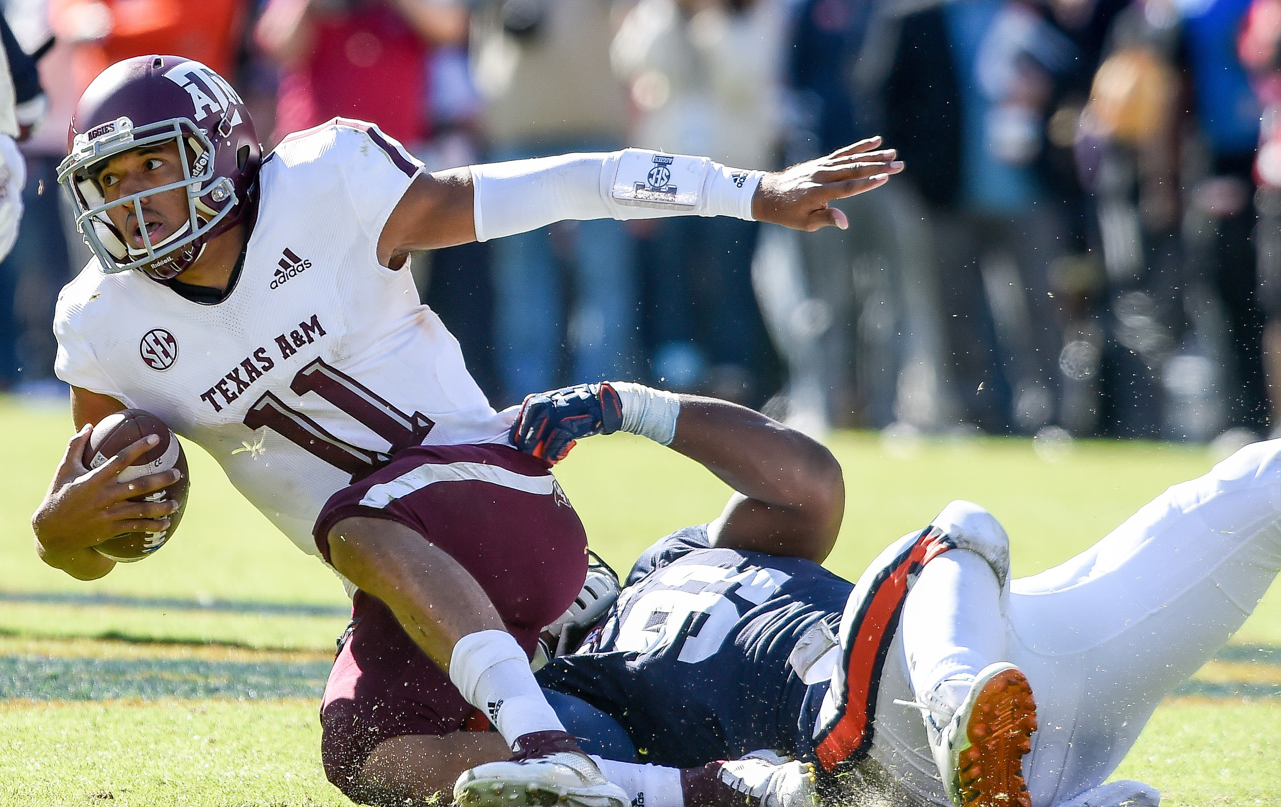 Texas A&M Aggies quarterback Kellen Mond (11) is pulled down by Auburn Tigers defensive lineman Nick Coe (91) during the second half of an NCAA football game Saturday, November 3, 2018, at Jordan-Hare Stadium in Auburn, Ala. (Photo by Jeff Johnsey)