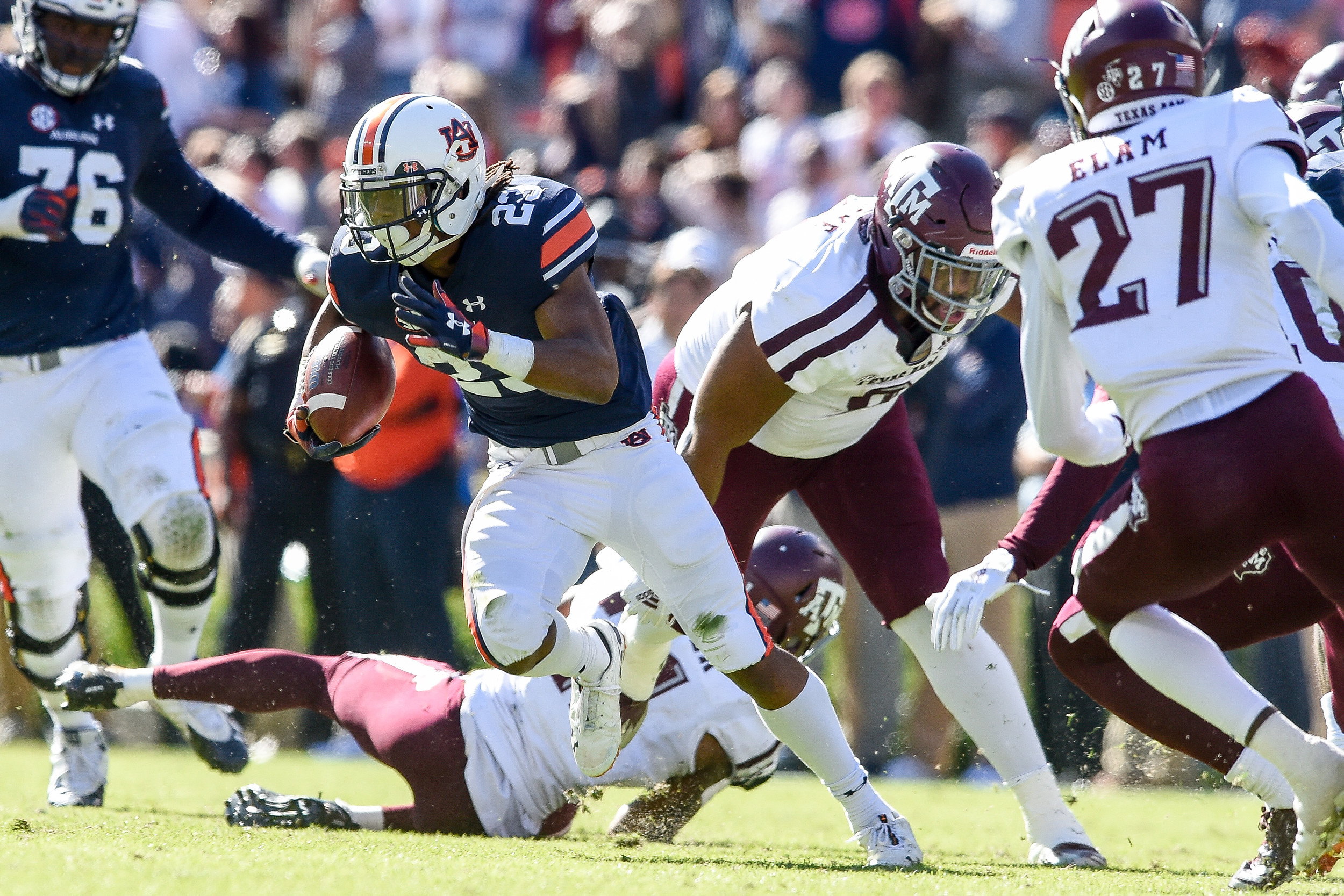 Auburn Tigers wide receiver Ryan Davis (23) breaks the tackle of Texas A&M Aggies defensive back Charles Oliver (21) during the second half of an NCAA football game Saturday, November 3, 2018, at Jordan-Hare Stadium in Auburn, Ala. (Photo by Jeff Johnsey)