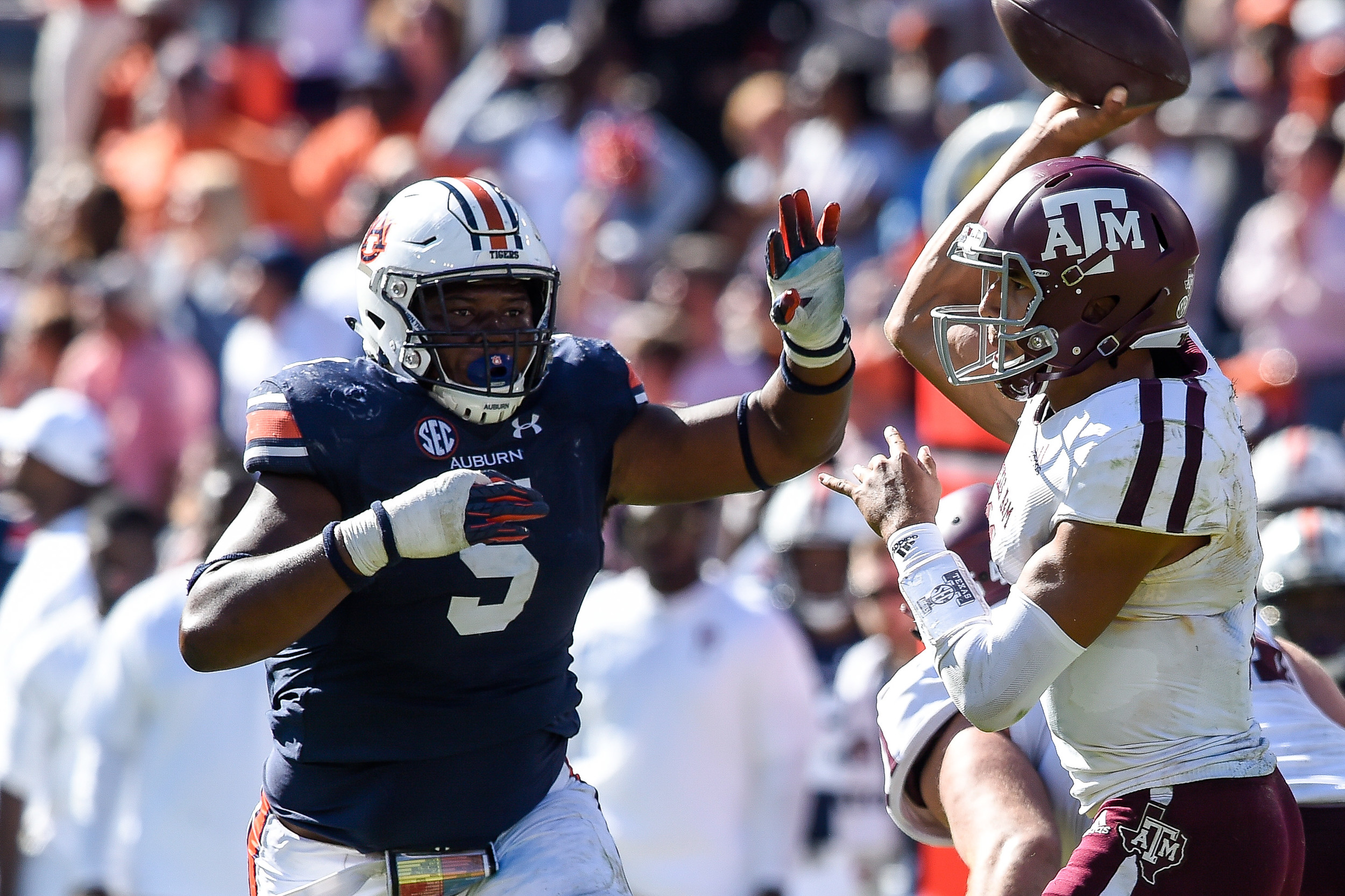 Auburn Tigers defensive lineman Derrick Brown (5) pressures Texas A&M Aggies quarterback Kellen Mond (11) during the second half of an NCAA football game against the Texas A&M Aggies Saturday, November 3, 2018, at Jordan-Hare Stadium in Auburn, Ala. (Photo by Jeff Johnsey)