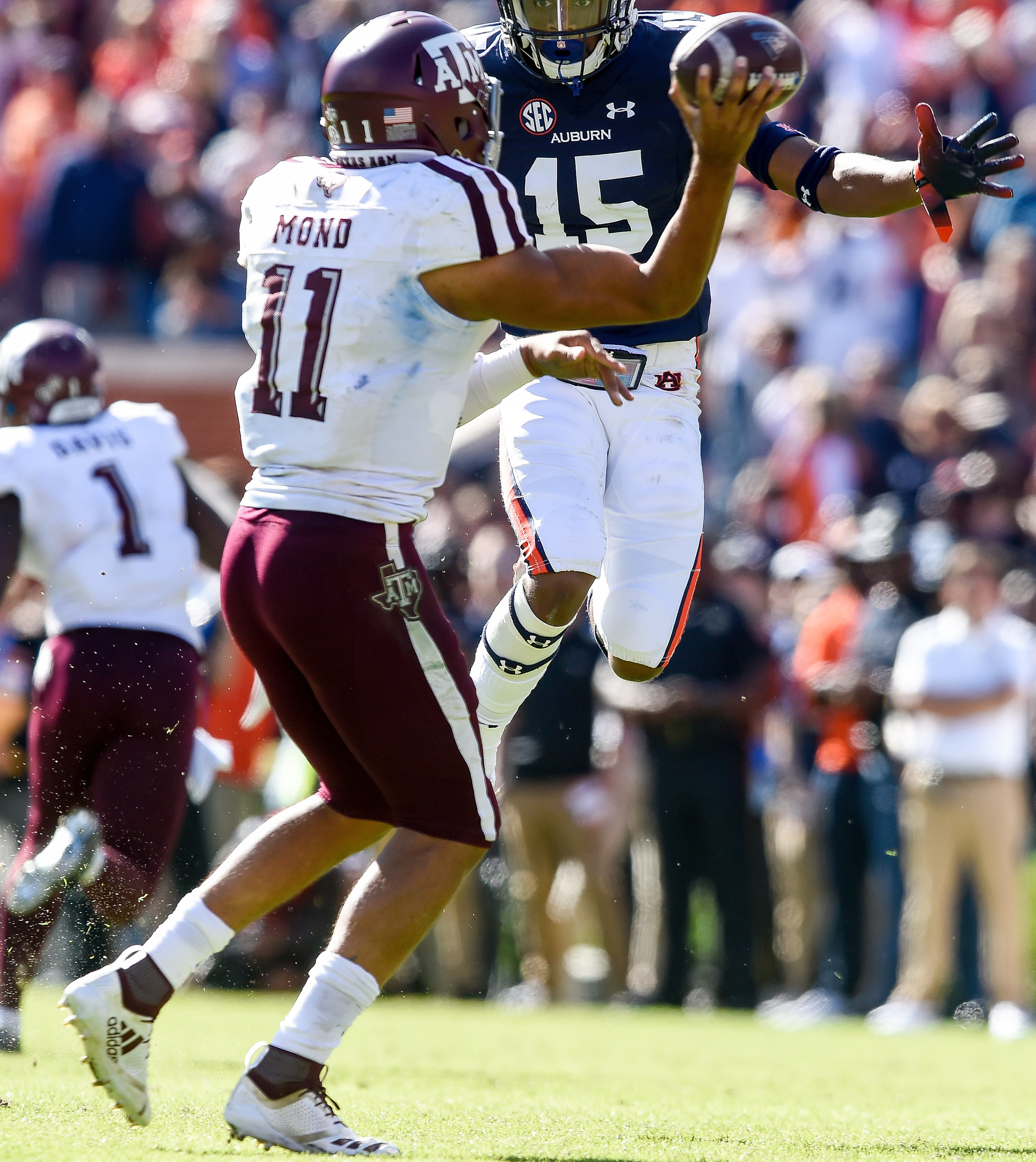 Texas A&M Aggies quarterback Kellen Mond (11) is pressured by Auburn Tigers defensive back Jordyn Peters (15) during the second half of an NCAA football game against the Texas A&M Aggies Saturday, November 3, 2018, at Jordan-Hare Stadium in Auburn, Ala. (Photo by Jeff Johnsey)