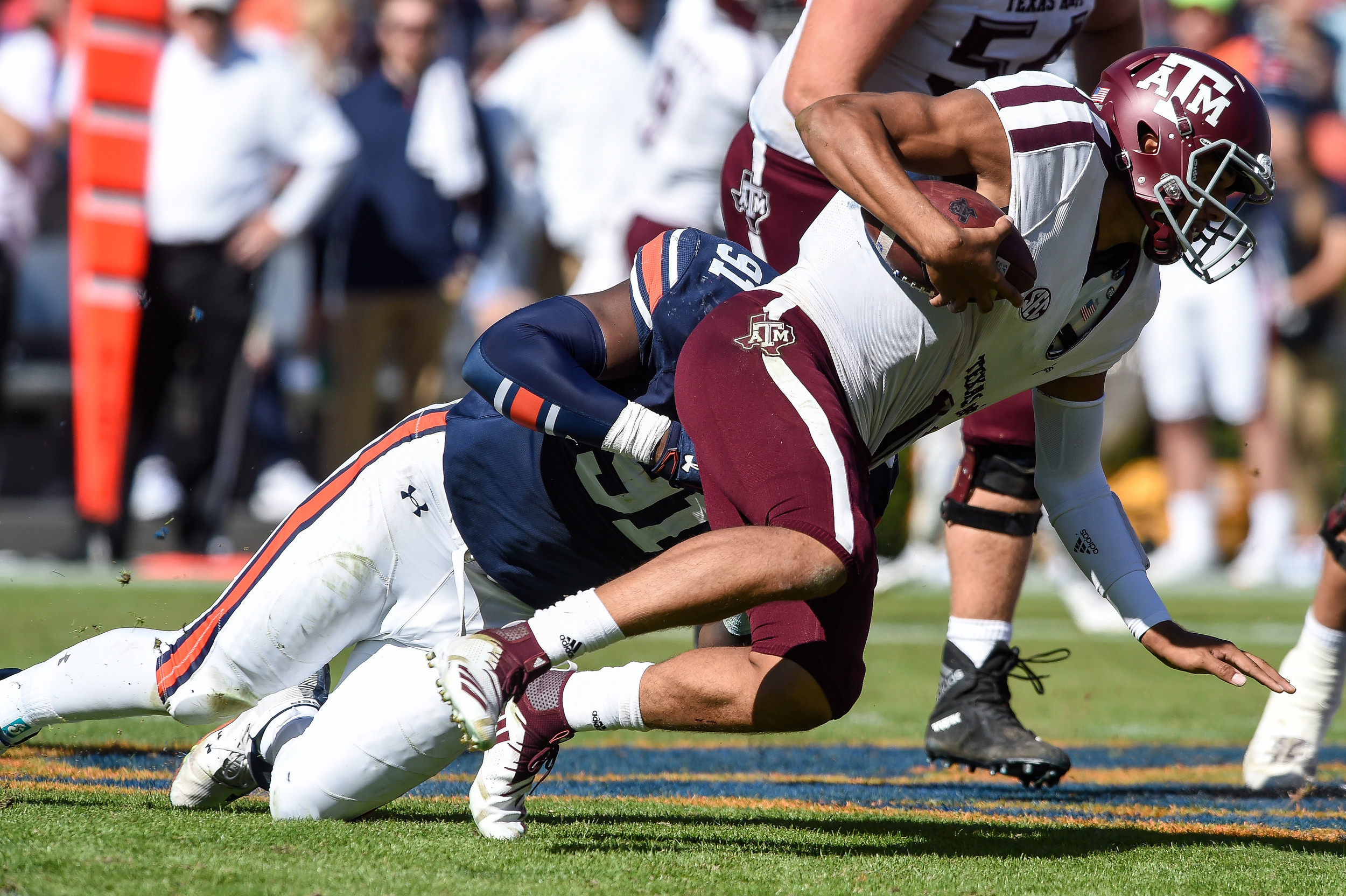 Auburn Tigers defensive lineman Nick Coe (91) tackles Texas A&M Aggies quarterback Kellen Mond (11) during the second half of an NCAA football game between the Auburn Tigers and Texas A&M Aggies Saturday, November 3, 2018, at Jordan-Hare Stadium in Auburn, Ala. (Photo by Jeff Johnsey)