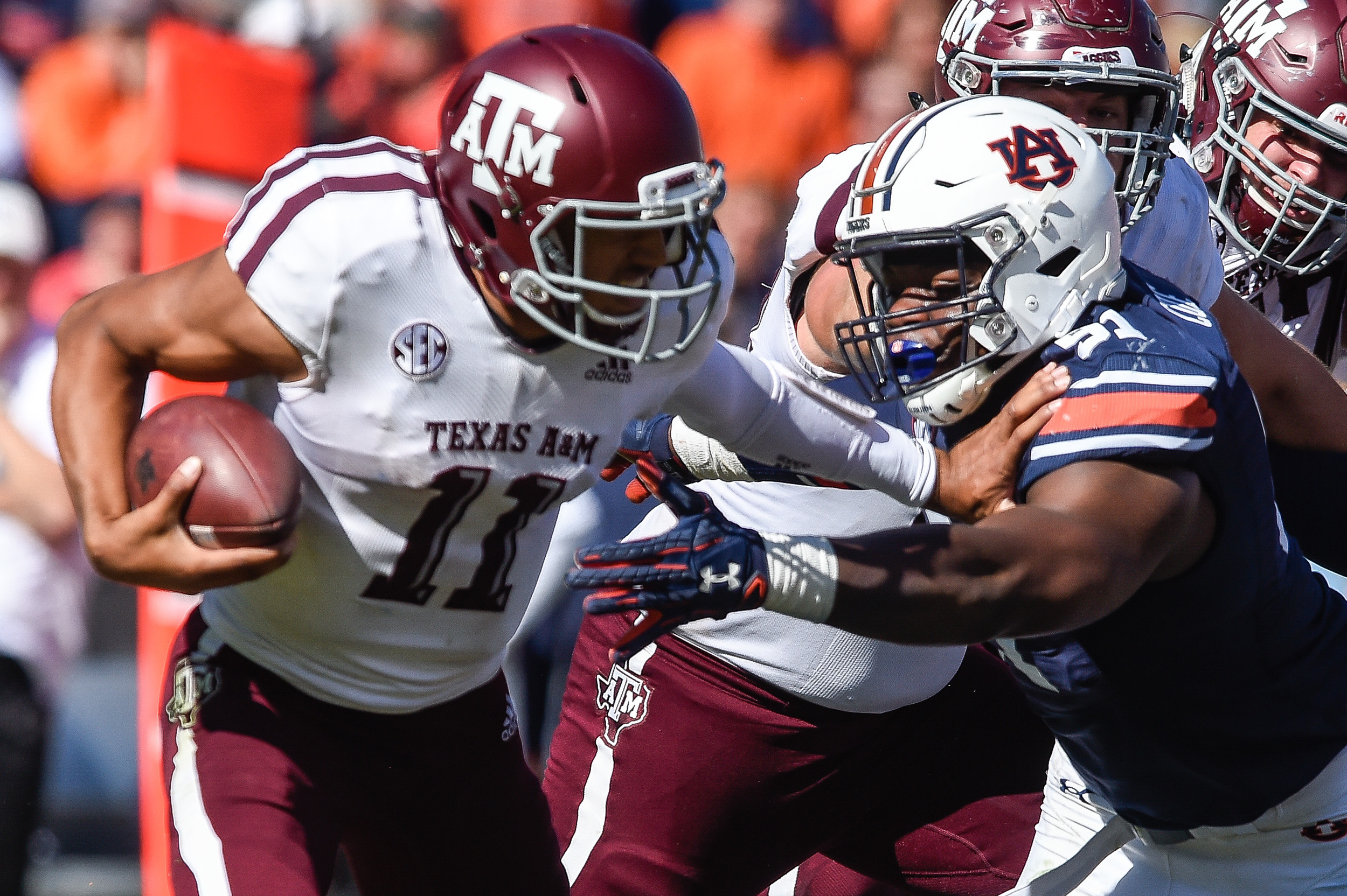 Texas A&M Aggies quarterback Kellen Mond (11) is brought down by Auburn Tigers defensive lineman Nick Coe (91) during the second half of an NCAA football game against the Texas A&M Aggies Saturday, November 3, 2018, at Jordan-Hare Stadium in Auburn, Ala. (Photo by Jeff Johnsey)