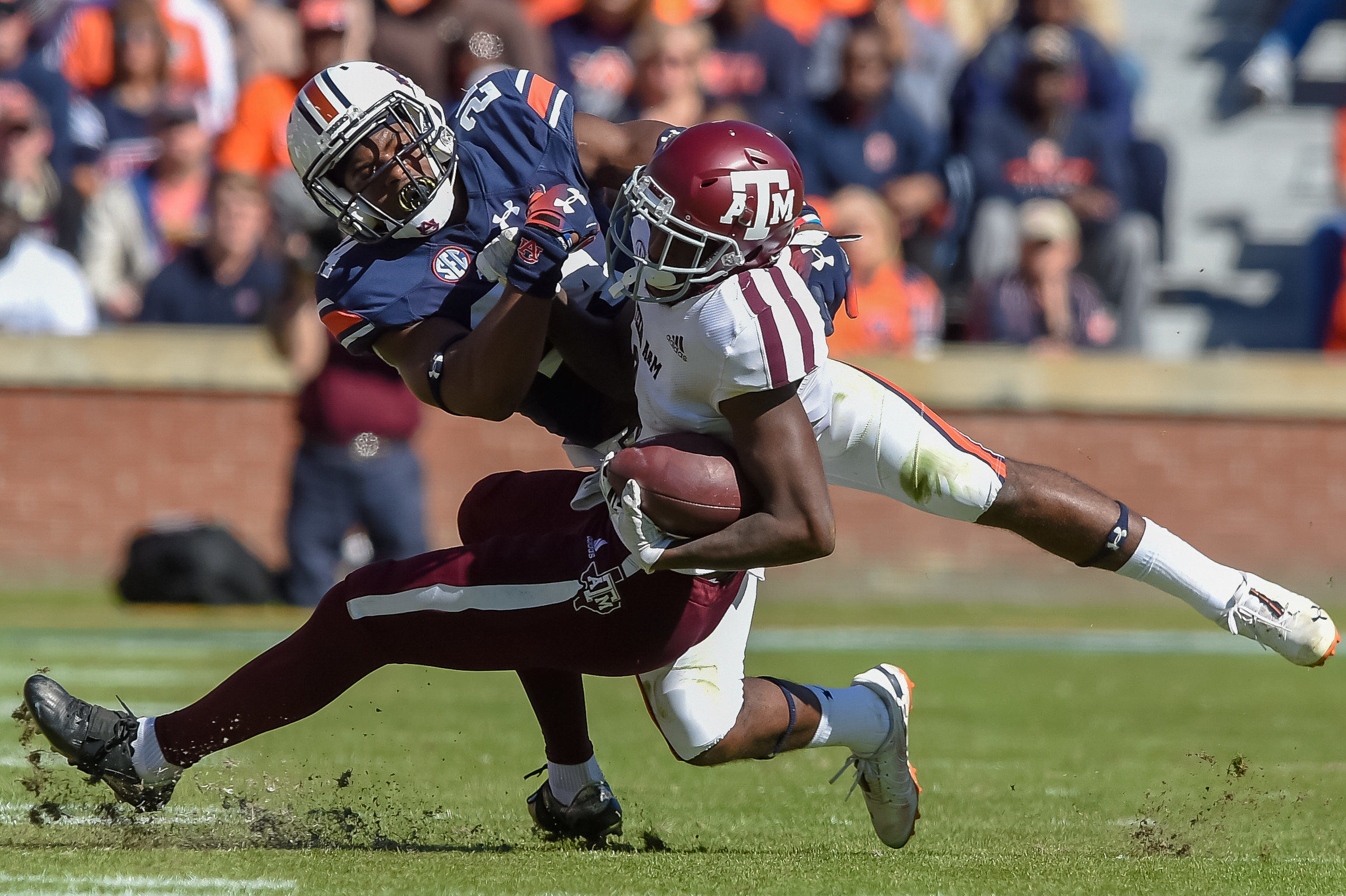 Auburn Tigers defensive back Daniel Thomas (24) tackles Texas A&M Aggies wide receiver Quartney Davis (1) during the first half of an NCAA football game against the Texas A&M Aggies Saturday, November 3, 2018, at Jordan-Hare Stadium in Auburn, Ala. (Photo by Jeff Johnsey)
