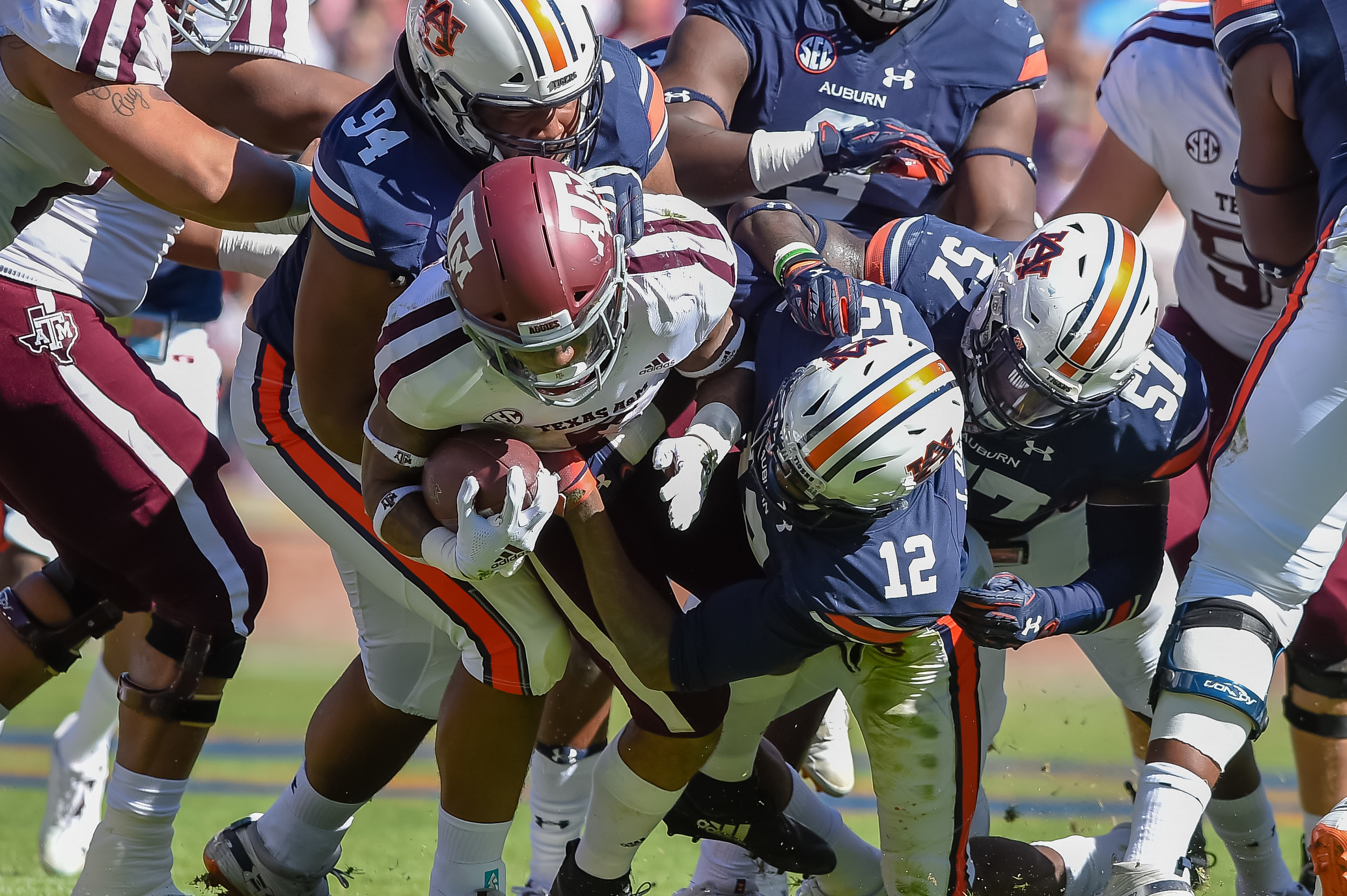 Texas A&M Aggies running back Trayveon Williams (5) is tackled by Auburn Tigers defensive lineman Tyrone Truesdell (94) and defensive back Jamel Dean (12) a during the first half of an NCAA football game against the Texas A&M Aggies Saturday, November 3, 2018, at Jordan-Hare Stadium in Auburn, Ala. (Photo by Jeff Johnsey)