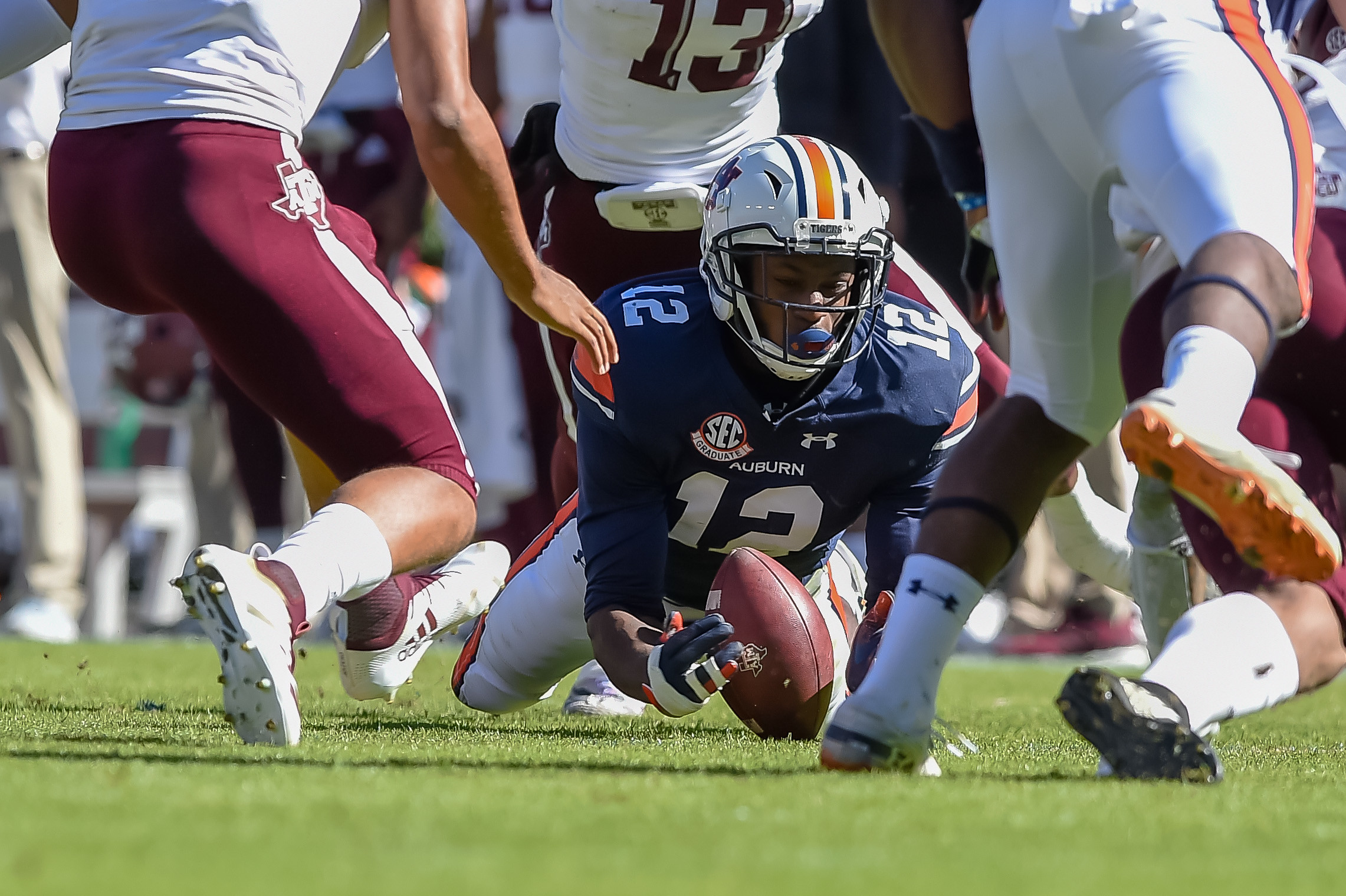 Auburn Tigers defensive back Jamel Dean (12) recovers a  fumble during the first half of an NCAA football game against the Texas A&M Aggies Saturday, November 3, 2018, at Jordan-Hare Stadium in Auburn, Ala. (Photo by Jeff Johnsey)