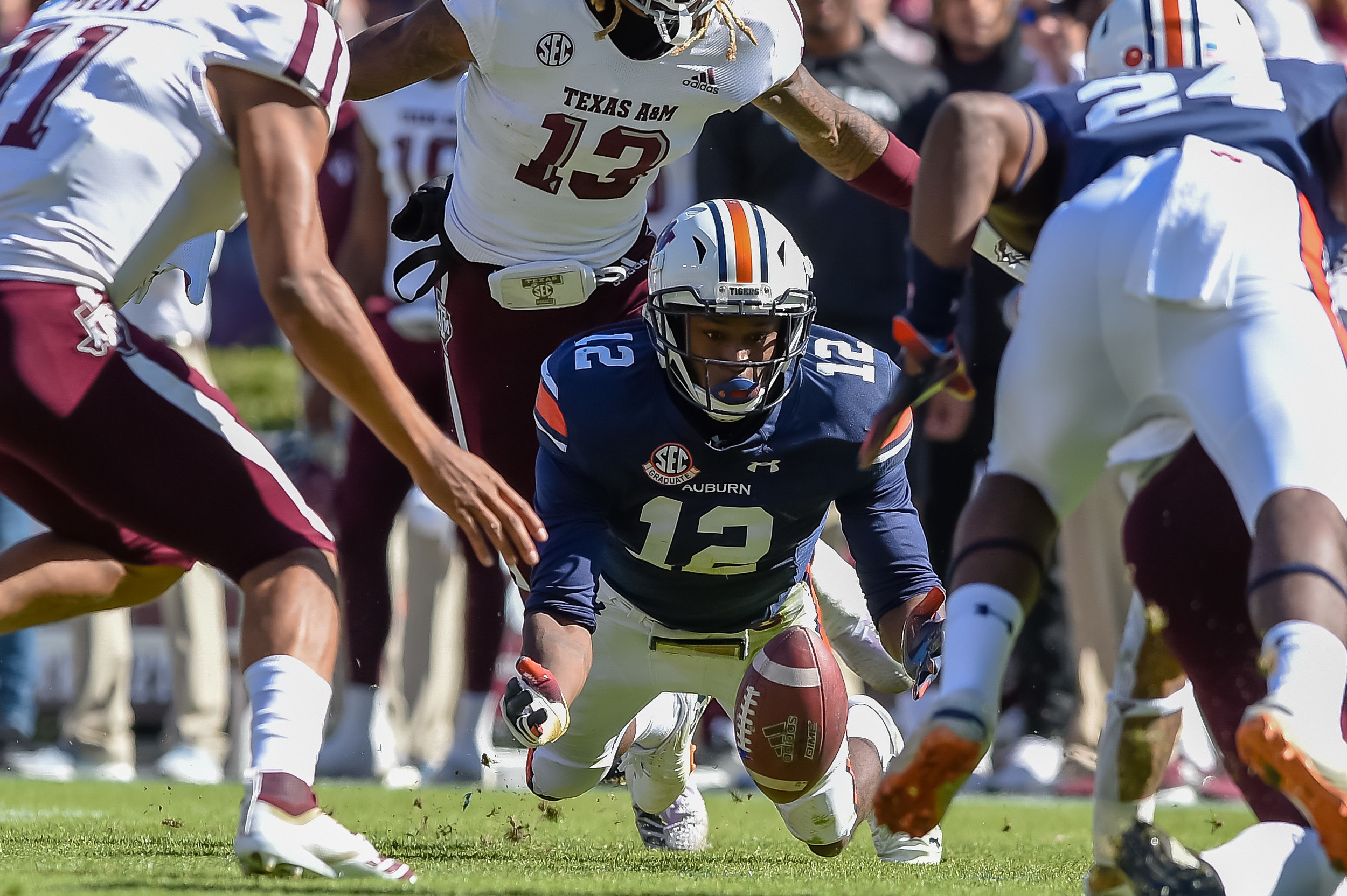 Auburn Tigers defensive back Jamel Dean (12) dives for.a fumble during the first half of an NCAA football game against the Texas A&M Aggies Saturday, November 3, 2018, at Jordan-Hare Stadium in Auburn, Ala. (Photo by Jeff Johnsey)