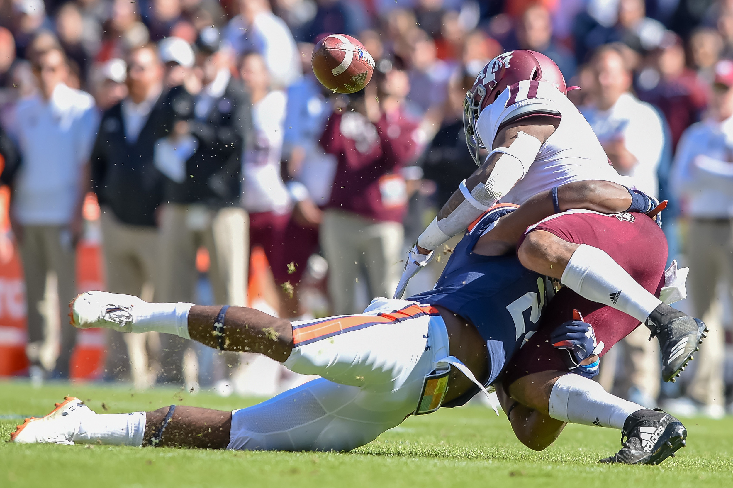 Auburn Tigers defensive back Daniel Thomas (24) causes a fumble by Texas A&M Aggies wide receiver Jhamon Ausbon (2) during the first half of an NCAA football game between the Auburn Tigers and Texas A&M Aggies Saturday, November 3, 2018, at Jordan-Hare Stadium in Auburn, Ala. (Photo by Jeff Johnsey)