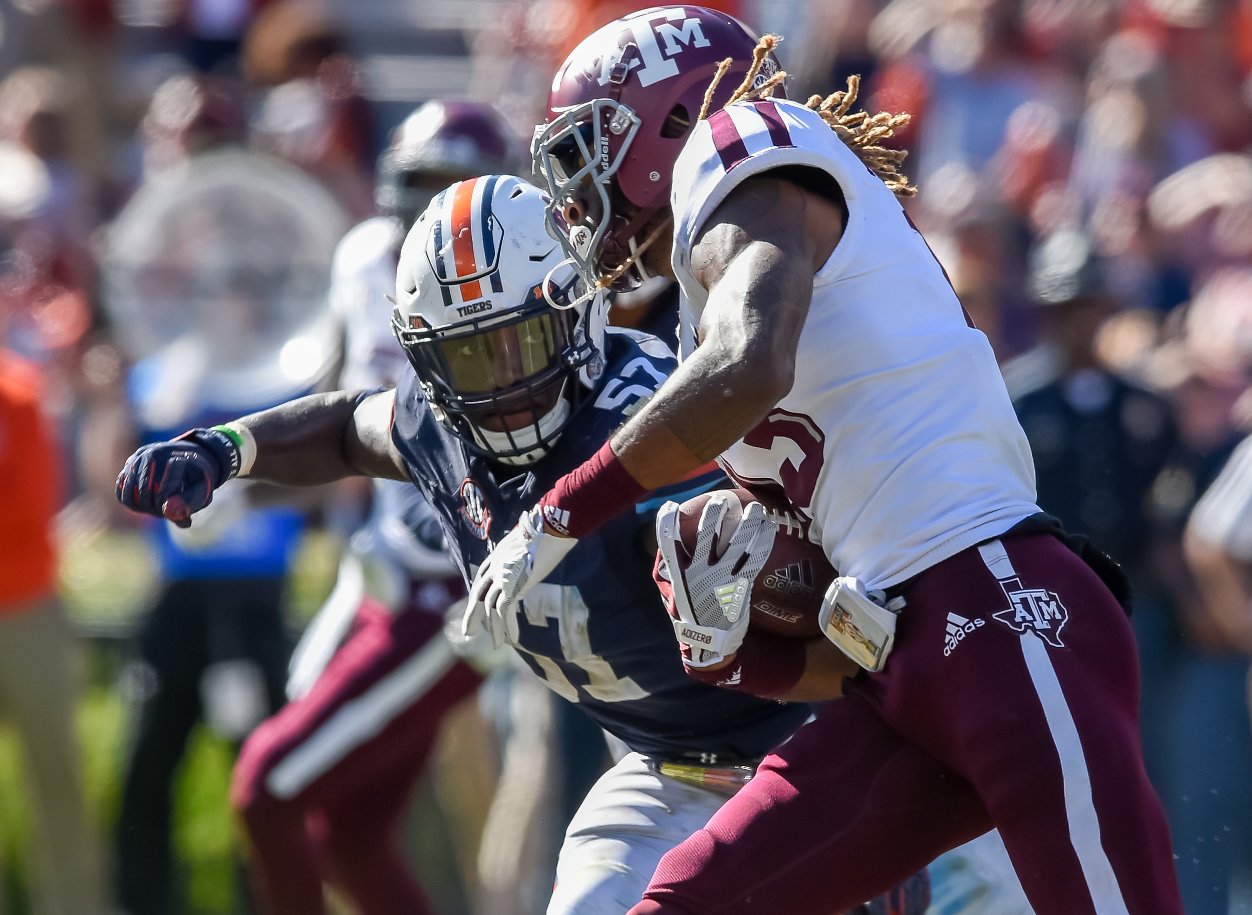 Auburn Tigers linebacker Deshaun Davis (57) eyes Texas A&M Aggies wide receiver Kendrick Rogers (13) during the second half of an NCAA football game Saturday, November 3, 2018, at Jordan-Hare Stadium in Auburn, Ala. (Photo by Jeff Johnsey)