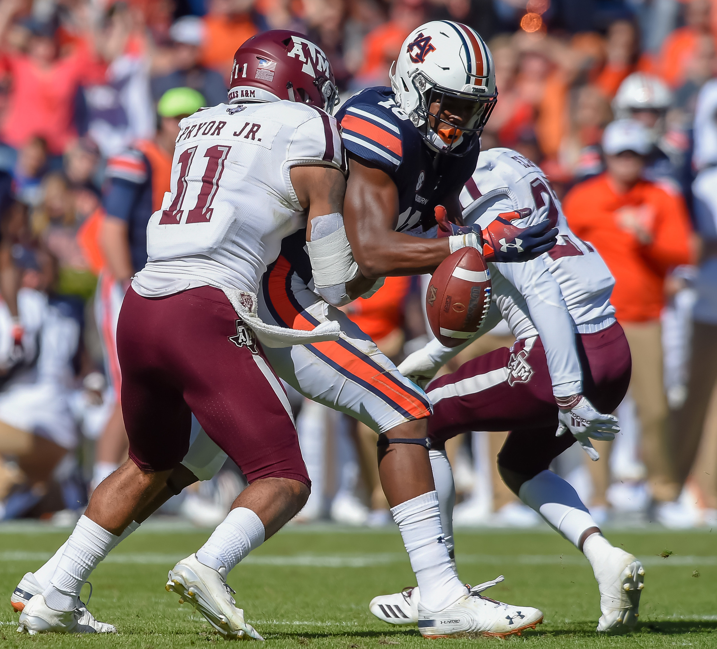Texas A&M Aggies defensive back Larry Pryor (11) breaks up a pass intended for Auburn Tigers wide receiver Seth Williams (18) during the second half of an NCAA football game Saturday, November 3, 2018, at Jordan-Hare Stadium in Auburn, Ala. (Photo by Jeff Johnsey)