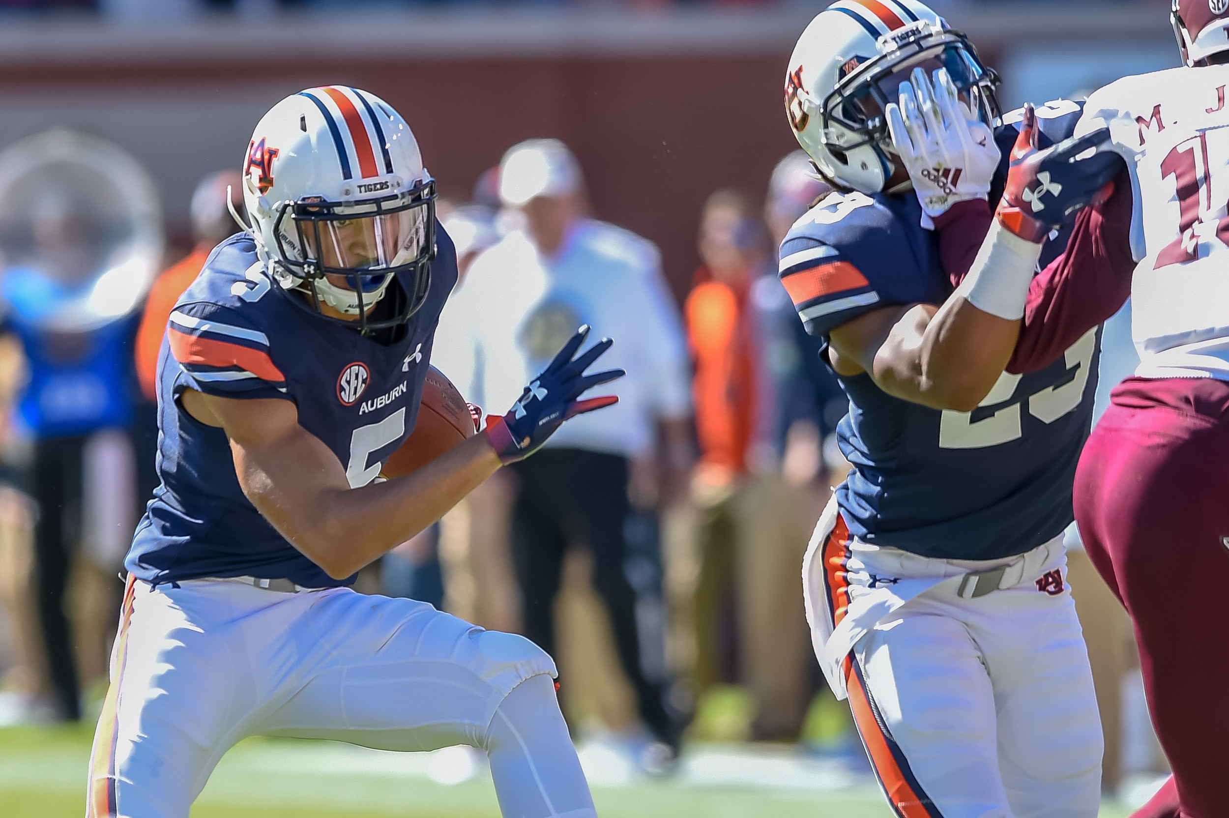 Auburn Tigers wide receiver Anthony Schwartz (5) runs behind the block of wide receiver Ryan Davis (23) during the first half of an NCAA football game against the Texas A&M Aggies Saturday, November 3, 2018, at Jordan-Hare Stadium in Auburn, Ala. (Photo by Jeff Johnsey)