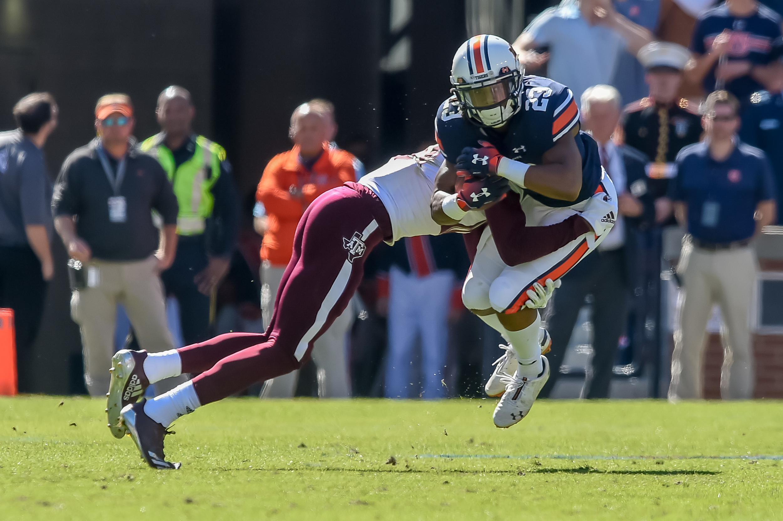 Auburn Tigers wide receiver Ryan Davis (23) is wrapped up by Texas A&M Aggies defensive back Myles Jones (10) during the first half of an NCAA football game Saturday, November 3, 2018, at Jordan-Hare Stadium in Auburn, Ala. (Photo by Jeff Johnsey)