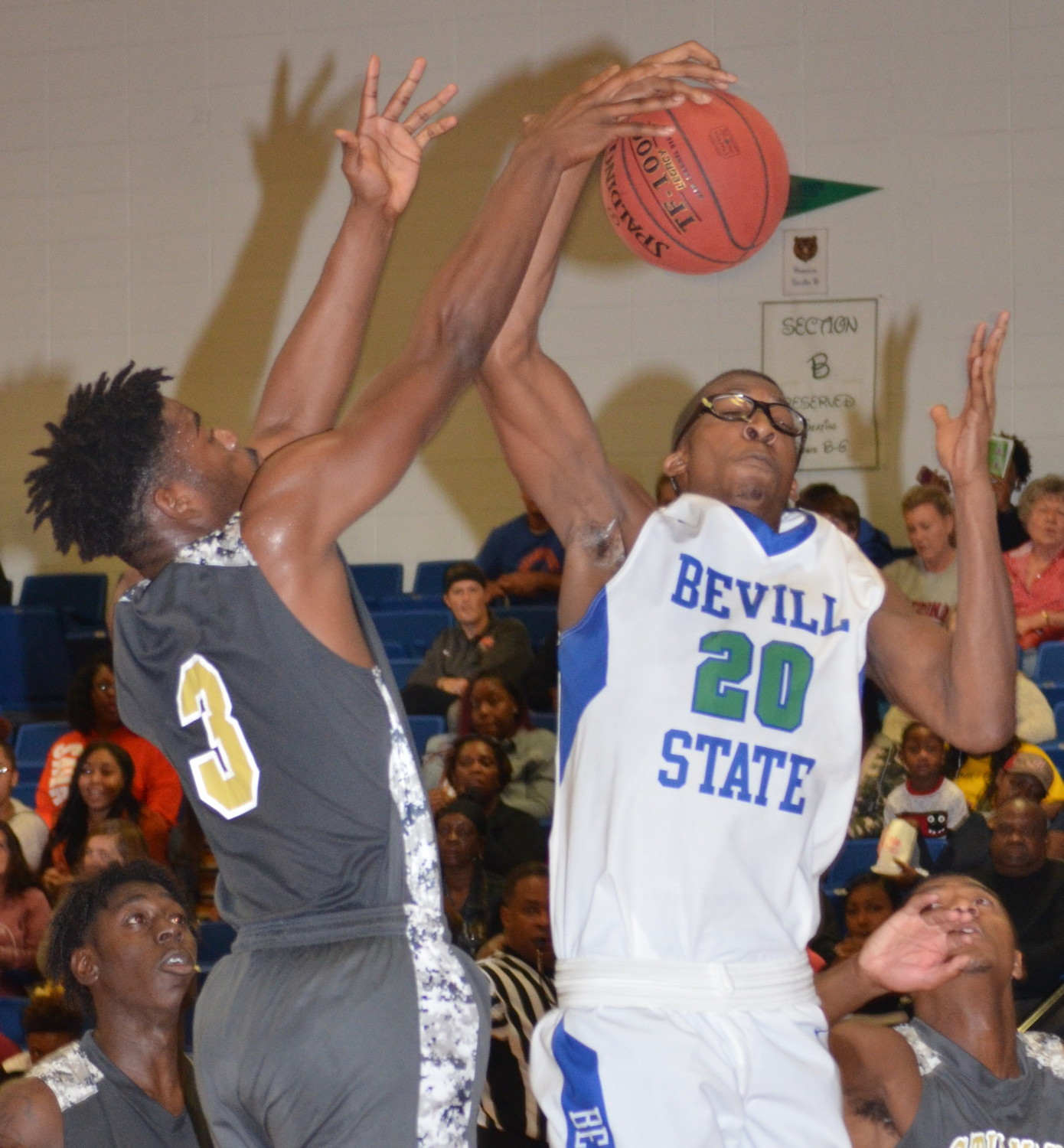 Bevill State's Nelson Haskin (20 pulls down a rebound in Saturday's season opener against the Stillman JV team. The Bears won 82-61.