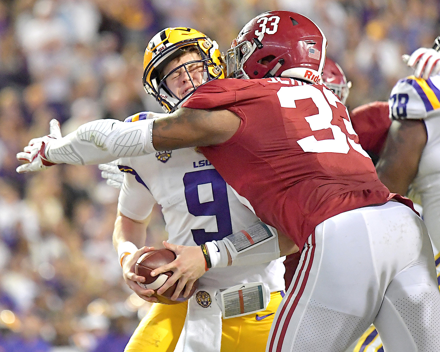 LSU Tigers quarterback Joe Burrow (9) gets sacked at the one-yard line by Alabama Crimson Tide linebacker Anfernee Jennings (33) in the second quarter of an NCAA football game Saturday, November 3, 2018, at Tiger Stadium in Baton Rouge, La.