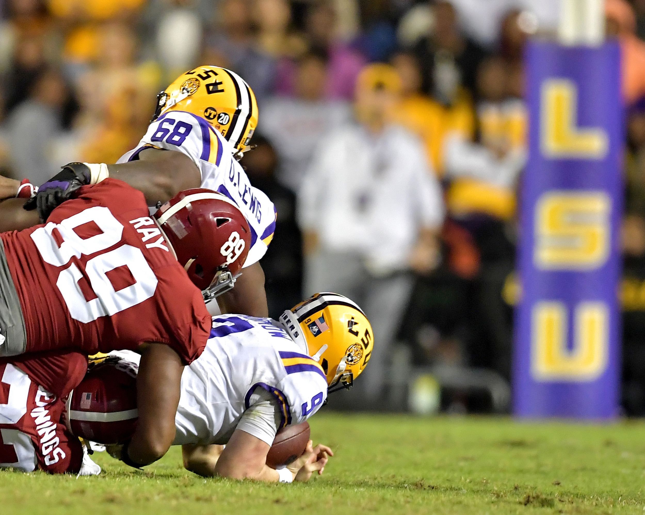 LSU Tigers quarterback Joe Burrow (9) is sacked yet again by Alabama Crimson Tide defensive linemen LaBryan Ray (89) and Raekwon Davis (99), and linebacker Anfernee Jennings (33), in the second half of an NCAA football game Saturday, November 3, 2018, at Tiger Stadium in Baton Rouge, La. (Photo by Lee Walls)