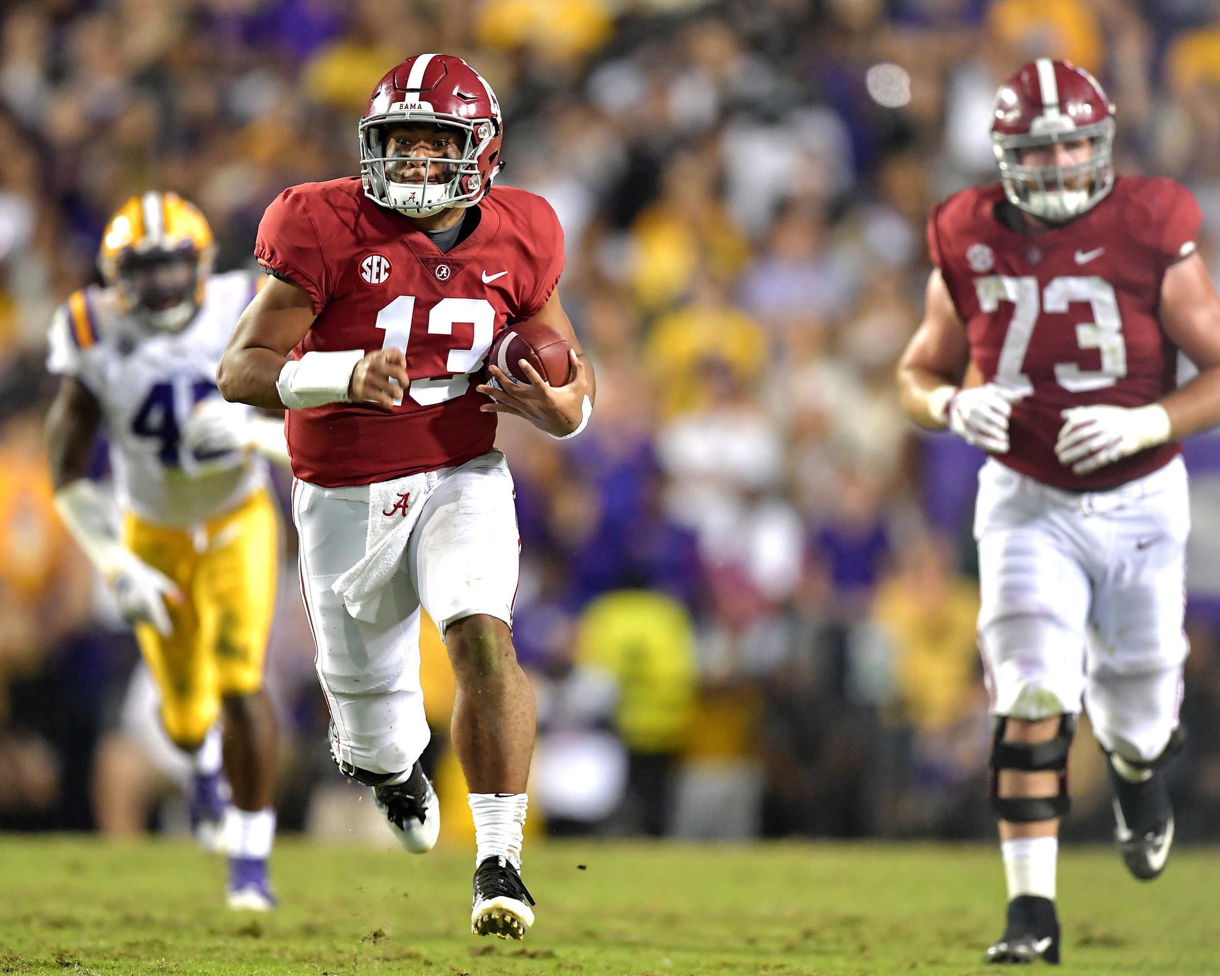 Alabama Crimson Tide quarterback Tua Tagovailoa (13) on his way to a touchdown in the second half of an NCAA football game against the LSU Tigers Saturday, November 3, 2018, at Tiger Stadium in Baton Rouge, La. Alabama wins 29-0. (Photo by Lee Walls)