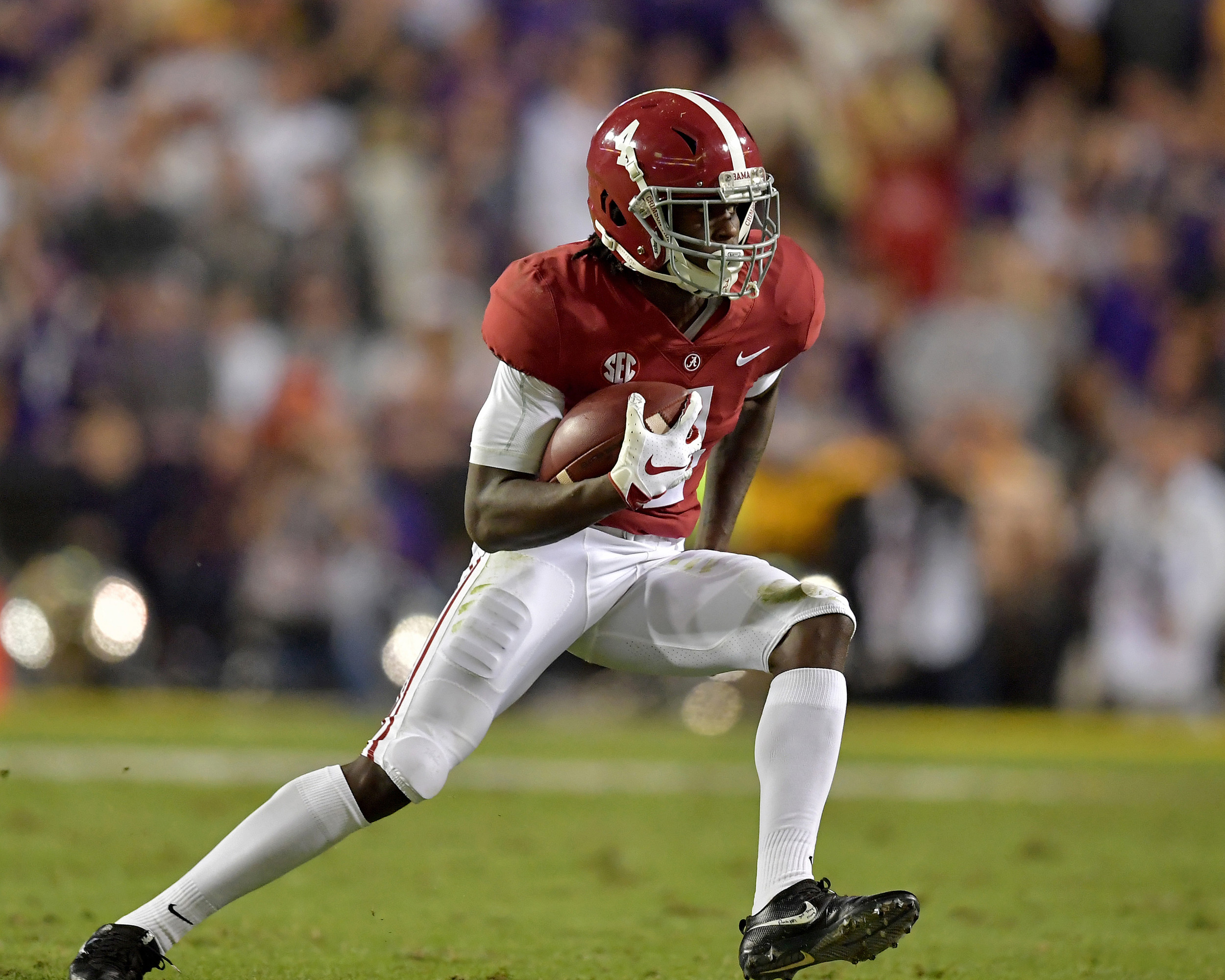 Alabama Crimson Tide wide receiver Jerry Jeudy (4) with a a reception and a long run in the first half of an NCAA football game against the LSU Tigers Saturday, November 3, 2018, at Tiger Stadium in Baton Rouge, La. Alabama wins 29-0. (Photo by Lee Walls)