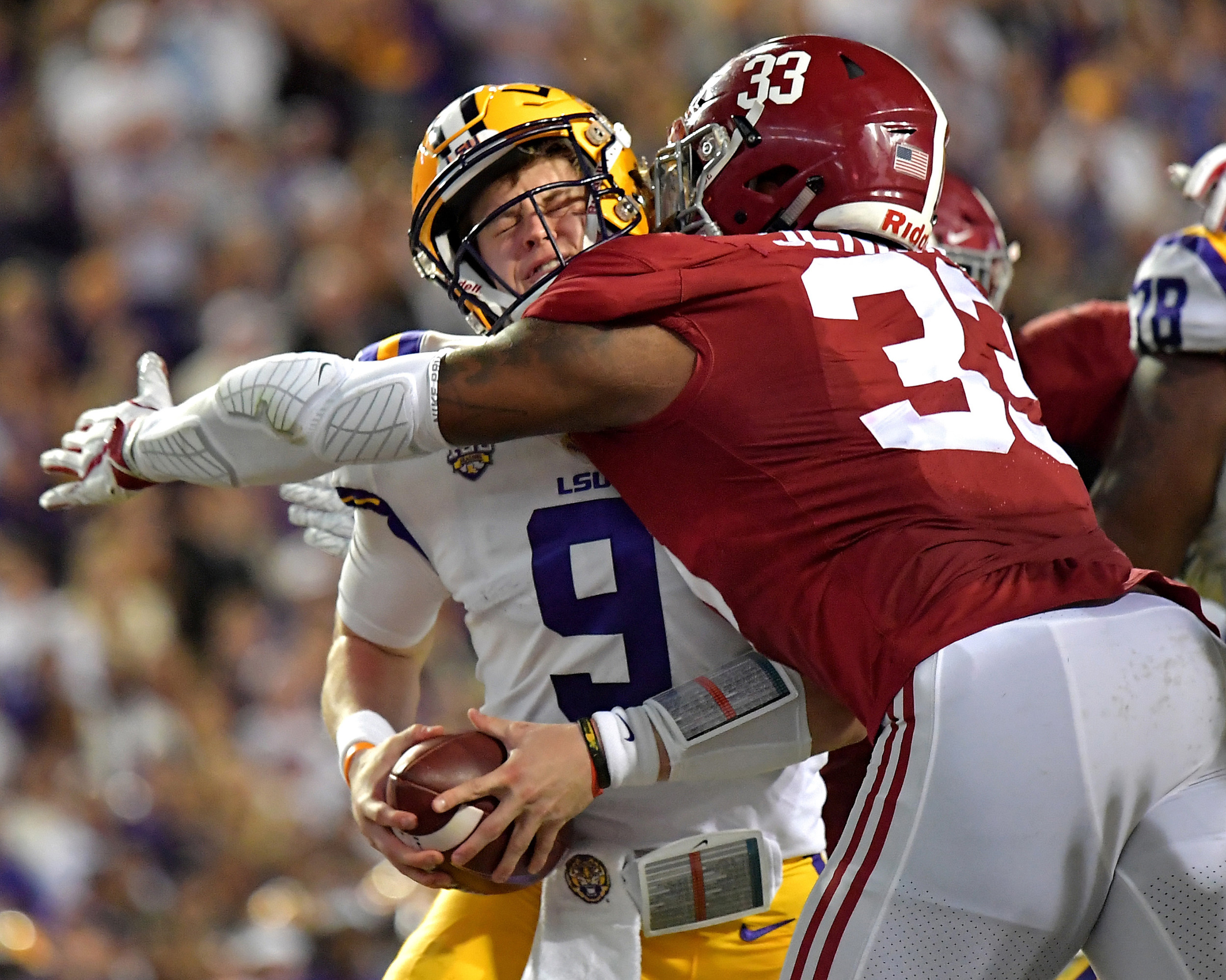 LSU Tigers quarterback Joe Burrow (9) is sacked by Alabama Crimson Tide linebacker Anfernee Jennings (33) in the first half of an NCAA football game Saturday, November 3, 2018, at Tiger Stadium in Baton Rouge, La. Alabama wins 29-0. (Photo by Lee Walls)
