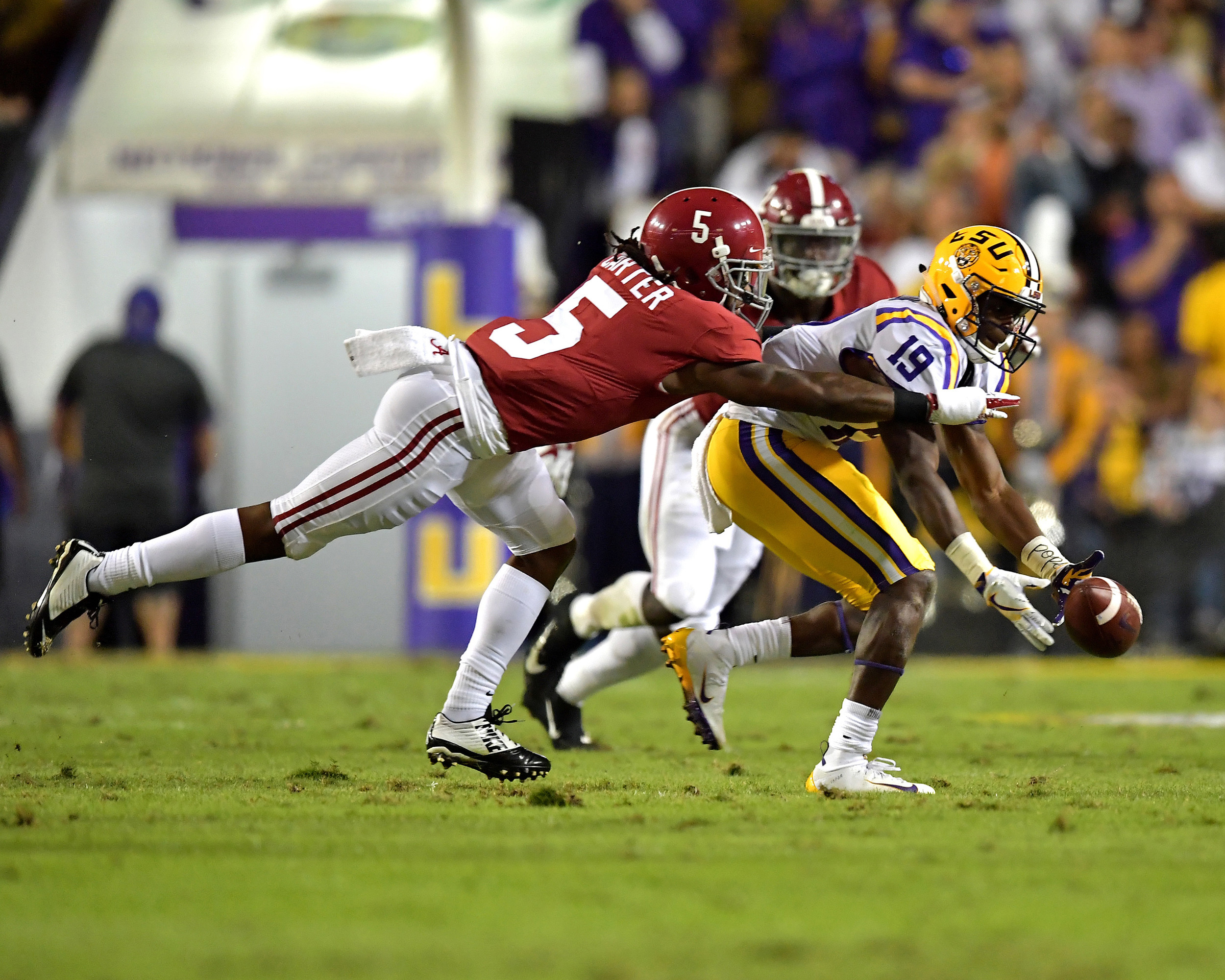 Alabama Crimson Tide defensive back Shyheim Carter (5) breaks up a pass intended for LSU Tigers wide receiver Derrick Dillon (19) during the first half of an NCAA football game Saturday, November 3, 2018, at Tiger Stadium in Baton Rouge, La. (Alabama wins 29-0. (Photo by Lee Walls)