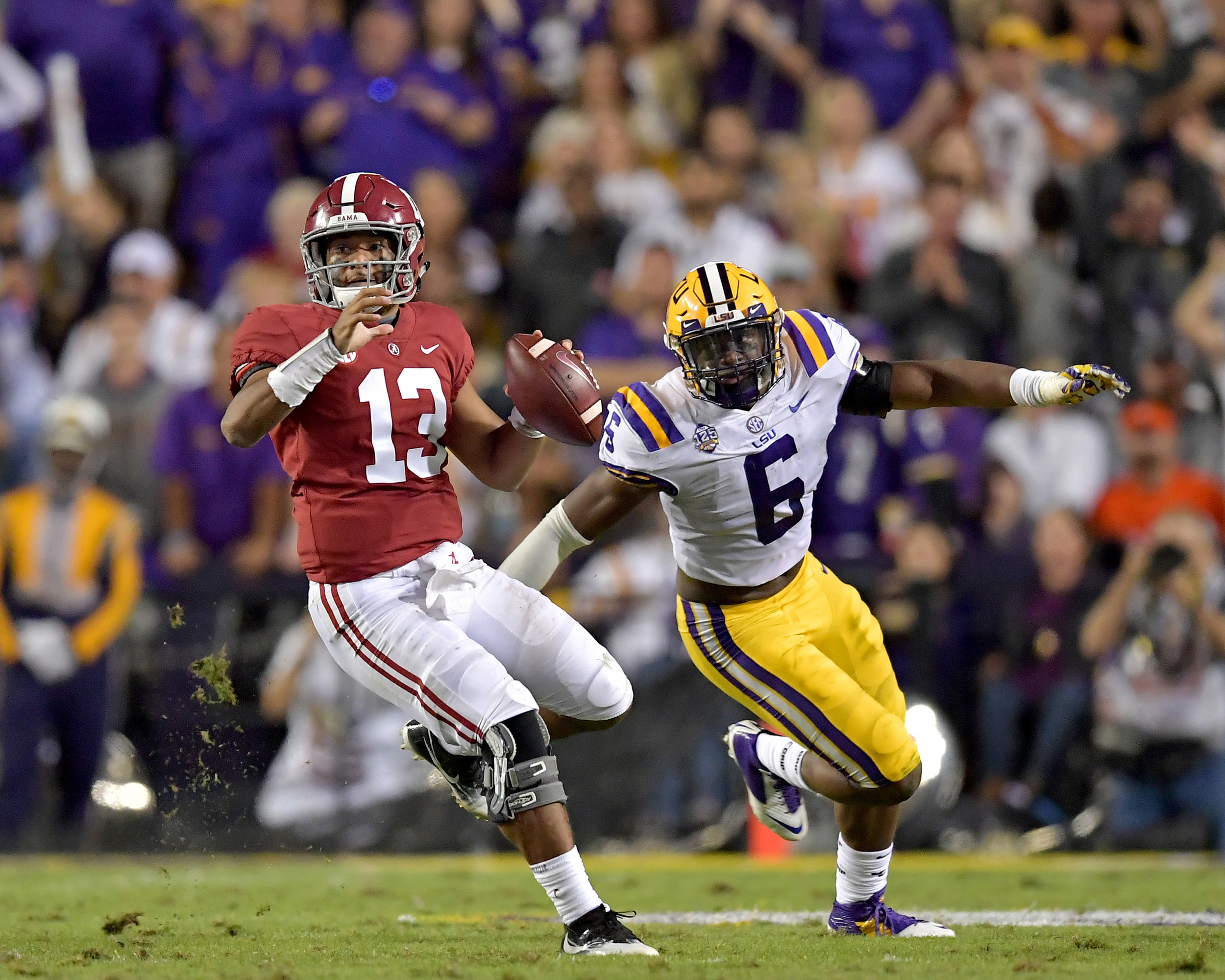 Alabama Crimson Tide quarterback Tua Tagovailoa (13) looks to make a play under pressure during the first half of an NCAA football game against the LSU Tigers Saturday, November 3, 2018, at Tiger Stadium in Baton Rouge, La. Alabama wins 29-0. (Photo by Lee Walls)