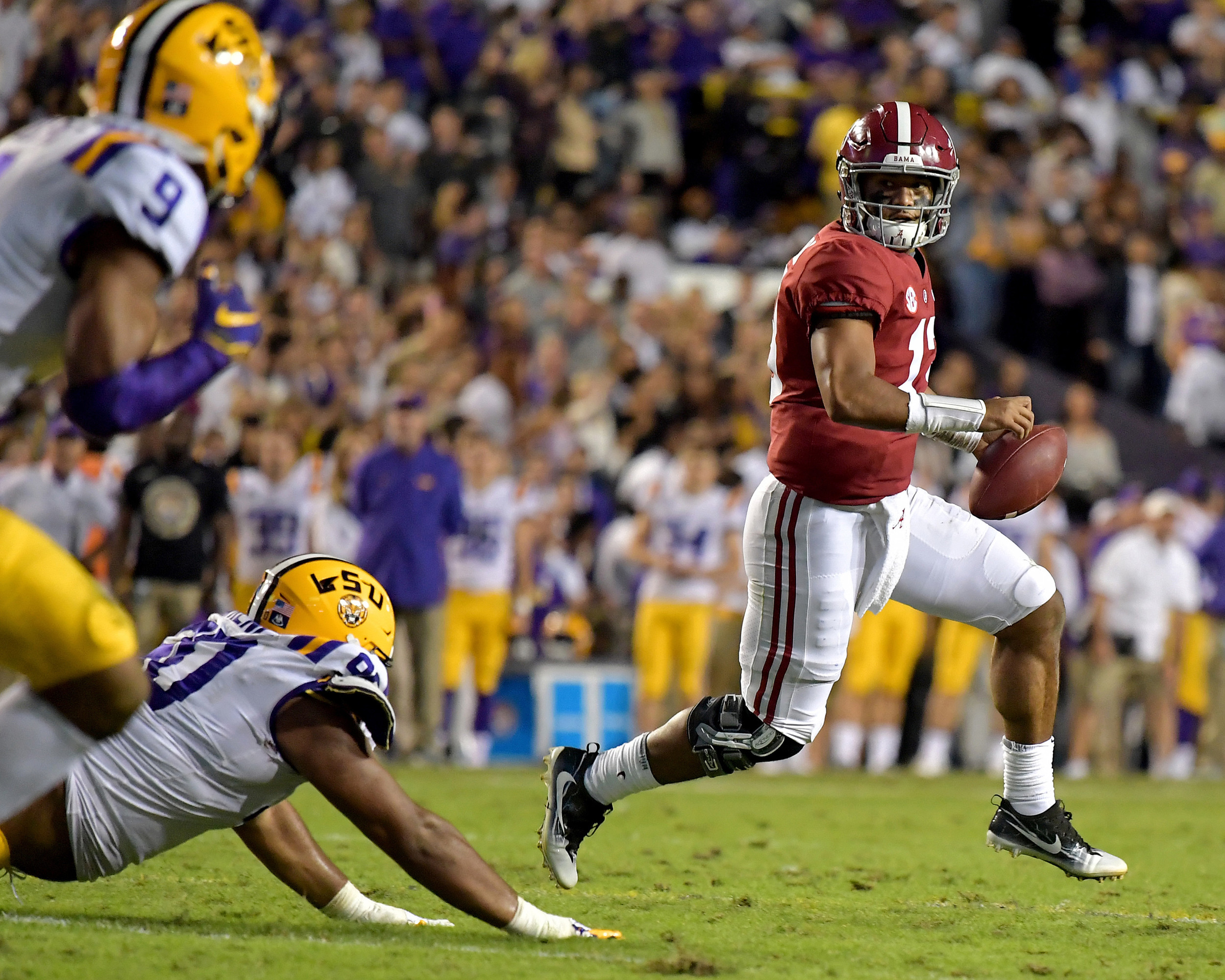 Alabama Crimson Tide quarterback Tua Tagovailoa (13) scrambles under pressure during the first half of an NCAA football game against the LSU Tigers Saturday, November 3, 2018, at Tiger Stadium in Baton Rouge, La. Alabama wins 29-0. (Photo by Lee Walls)