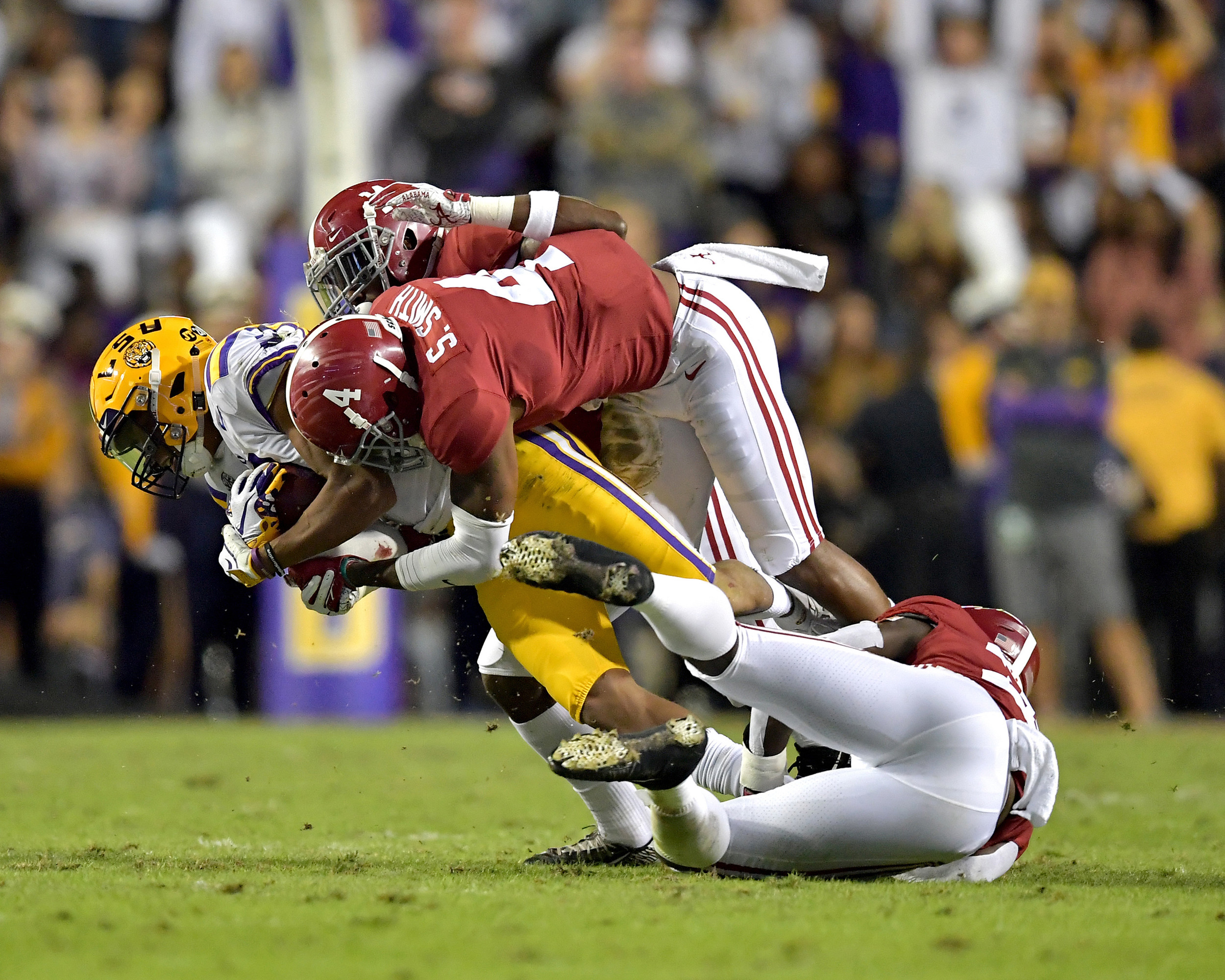 An LSU Tigers player is swarmed by the Alabama Crimson Tide defense in the first half of an NCAA football game Saturday, November 3, 2018, at Tiger Stadium in Baton Rouge, La. Alabama wins 29-0. (Photo by Lee Walls)