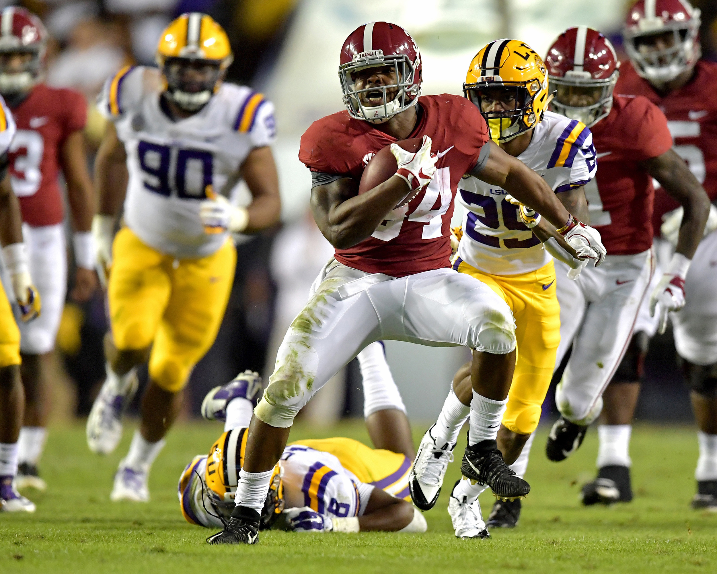 Alabama Crimson Tide running back Damien Harris (34) outruns LSU Tigers linebacker Patrick Queen (8) in the first quarter of an NCAA football game Saturday, November 3, 2018, at Tiger Stadium in Baton Rouge, La. Alabama wins 29-0. (Photo by Lee Walls)
