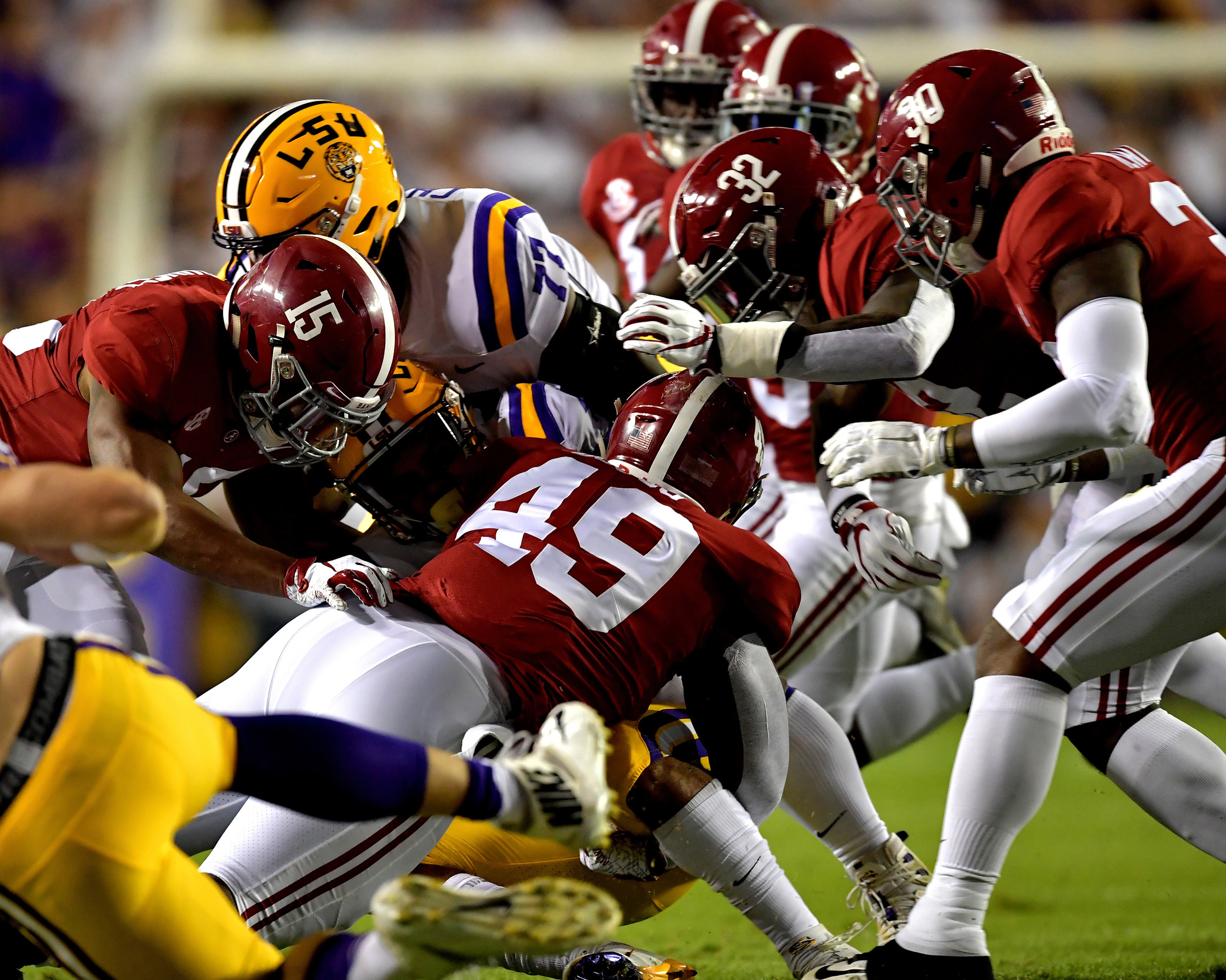 The Alabama Crimson Tide defense swarms an LSU player during the first half of an NCAA football game between Alabama and the LSU Tigers Saturday, November 3, 2018, at Tiger Stadium in Baton Rouge, La. Alabama wins 29-0. (Photo by Lee Walls)