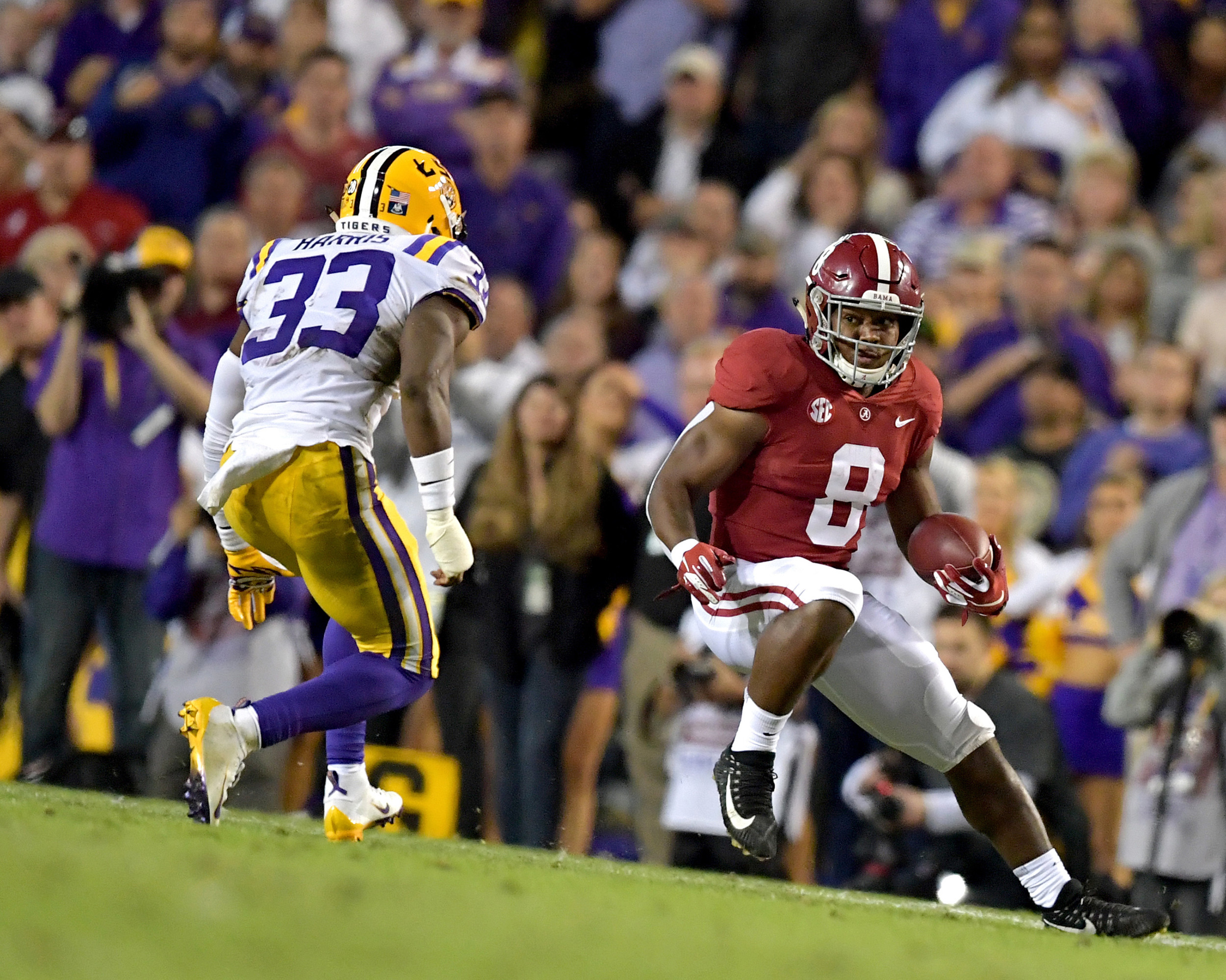Alabama Crimson Tide running back Josh Jacobs (8) prepares to switch direction to avoid a tackle by LSU Tigers safety Todd Harris Jr. (33) in the first half of an NCAA football game Saturday, November 3, 2018, at Tiger Stadium in Baton Rouge, La.  Alabama wins 29-0. (Photo by Lee Walls)