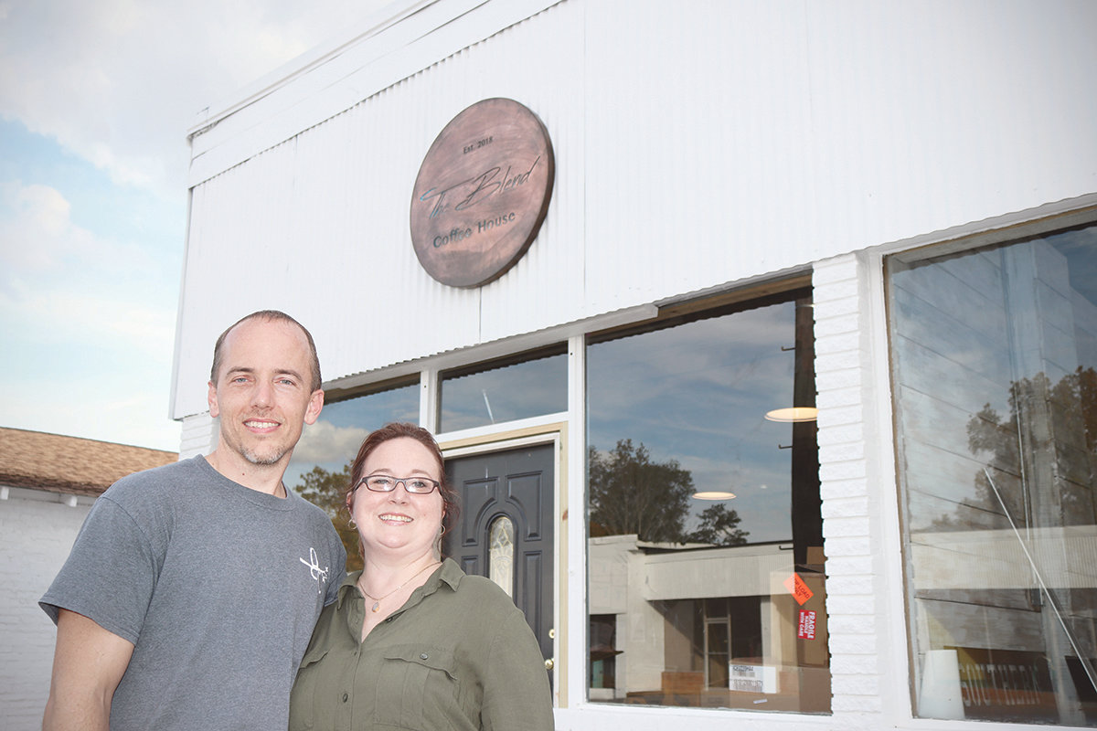 Joey and Nancy Clark are standing in front of The Blend Coffee House that will open later in November in one of the newly renovated buildings on Main Street Sumiton.