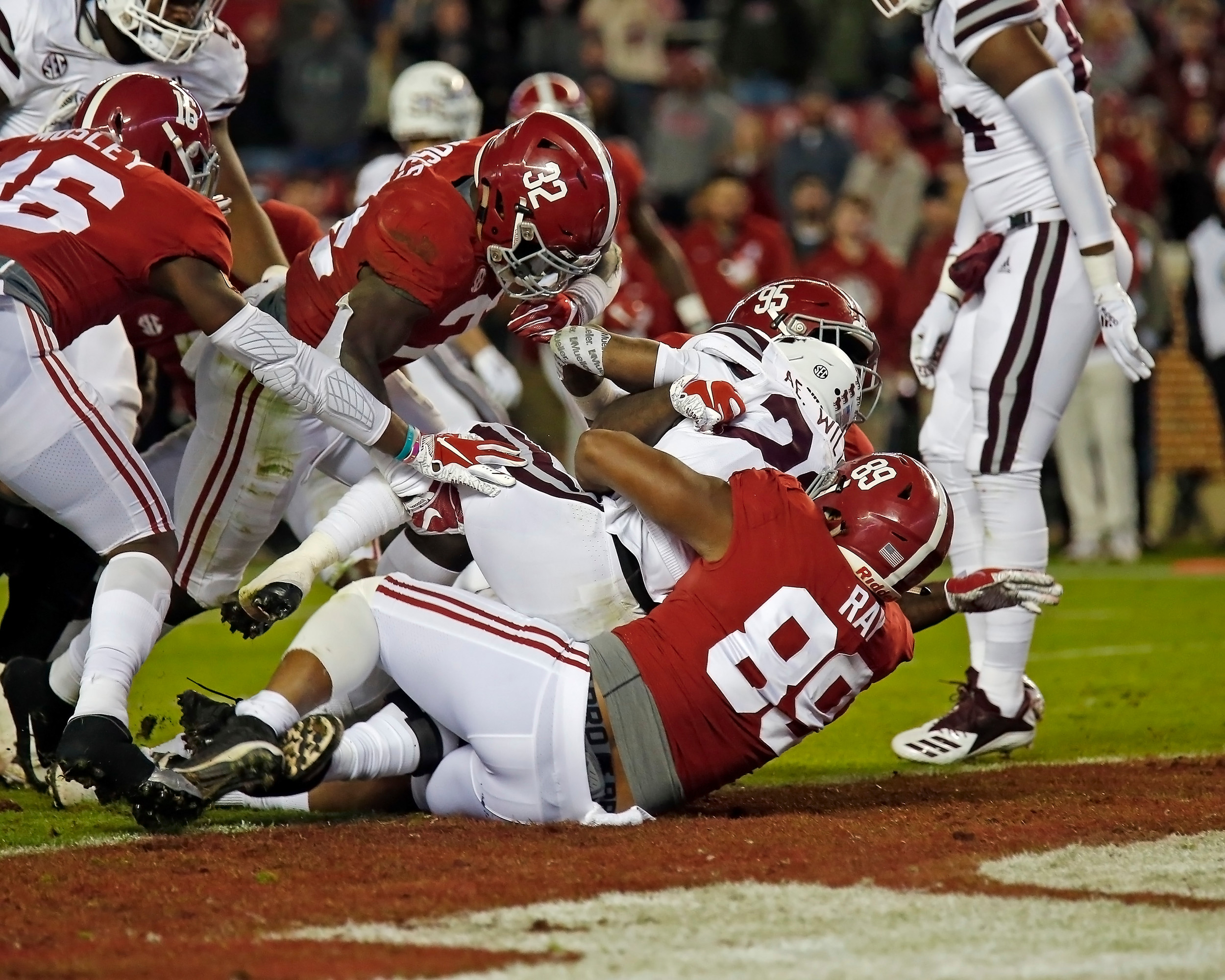 Alabama Crimson Tide defensive linemen Johnny Dwight (95) and LaBryan Ray (89) stop Mississippi State for no gain during the second half of the game between Mississippi State and the University of Alabama at Bryant-Denny Stadium in Tuscaloosa, Al. Credit: Jason Clark / Daily Mountain Eagle