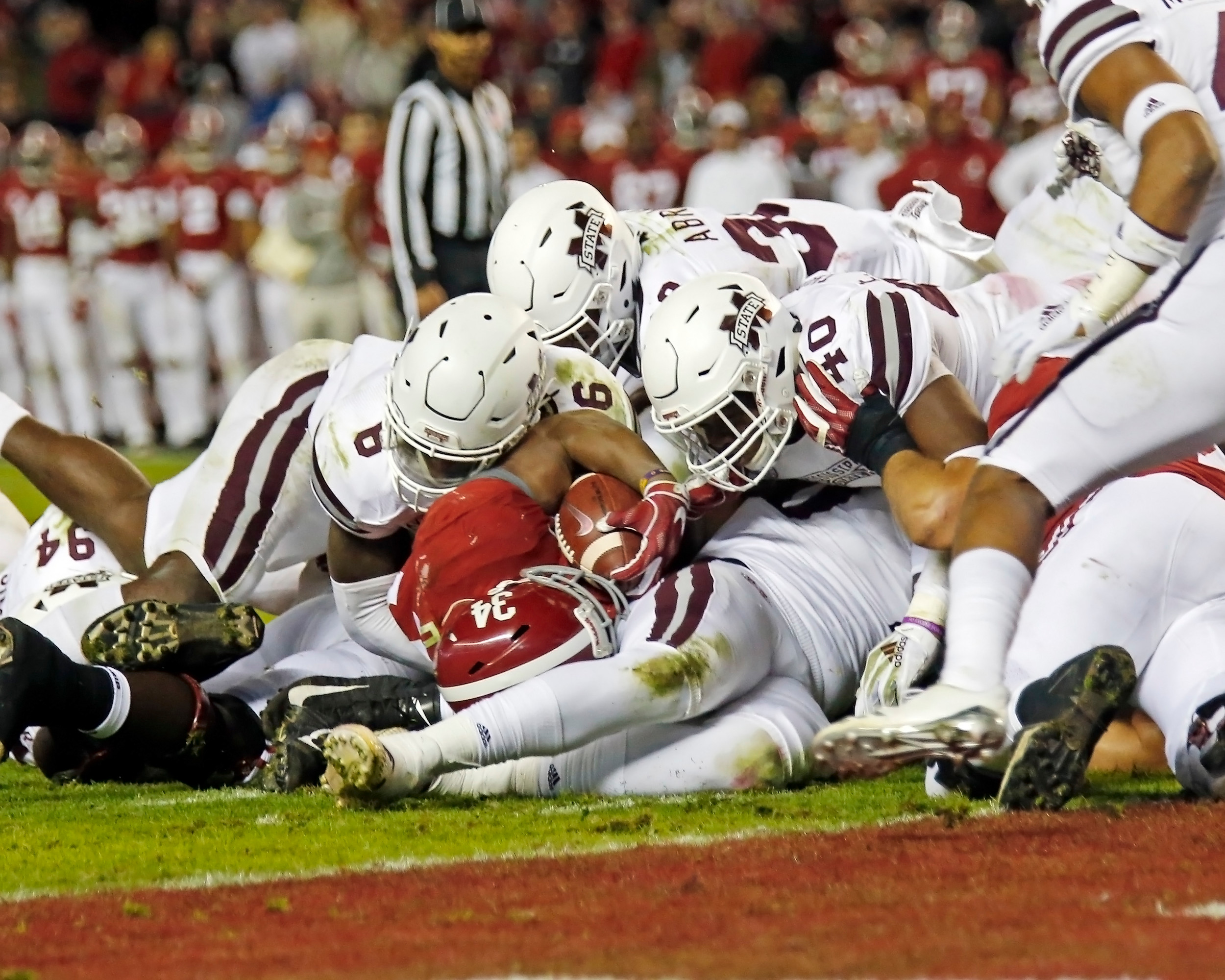 The Mississippi State Bulldogs' defense makes a big stop on Alabama Crimson Tide running back Damien Harris (34) during the second half of the game between Mississippi State and the University of Alabama at Bryant-Denny Stadium in Tuscaloosa, Al. Credit: Jason Clark / Daily Mountain Eagle