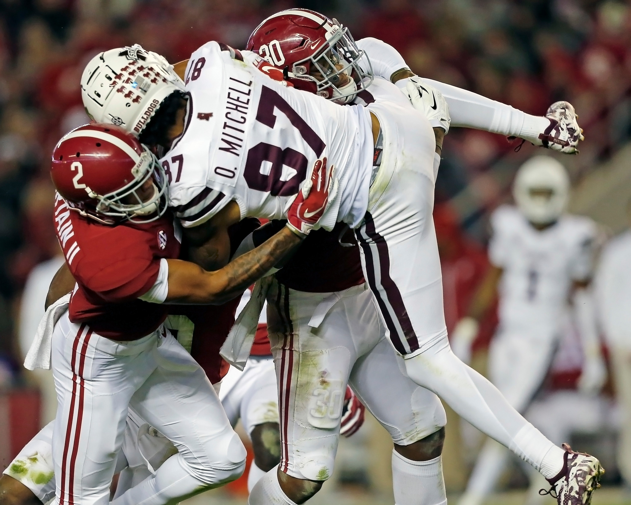 Mississippi State Bulldogs wide receiver Osirus Mitchell (87) was helpless when Alabama Crimson Tide defensive back Patrick Surtain II (2) and linebacker Mack Wilson (30) got a hold of him during the second half of the game between Mississippi State and the University of Alabama at Bryant-Denny Stadium in Tuscaloosa, Al. Credit: Jason Clark / Daily Mountain Eagle