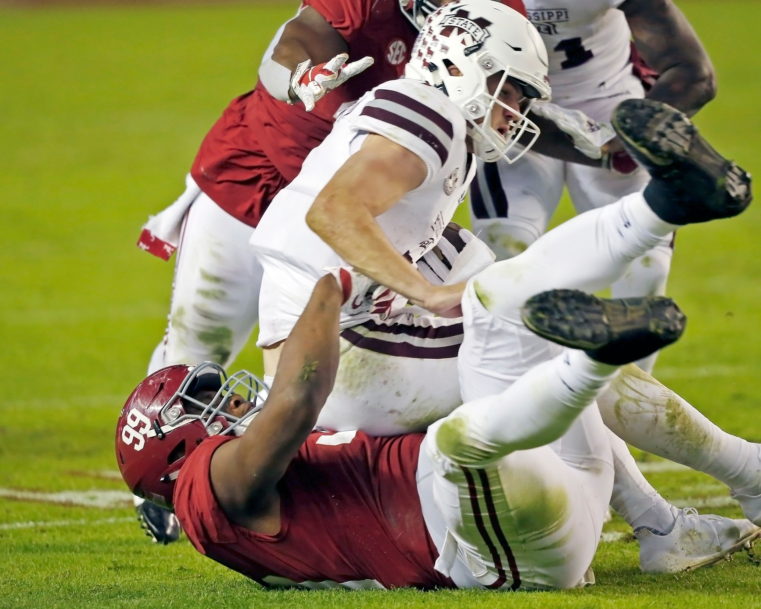 Alabama Crimson Tide defensive lineman Raekwon Davis (99) saks Mississippi State Bulldogs quarterback Nick Fitzgerald (7) again during the second half of the game between Mississippi State and the University of Alabama at Bryant-Denny Stadium in Tuscaloosa, Al. Credit: Jason Clark / Daily Mountain Eagle
