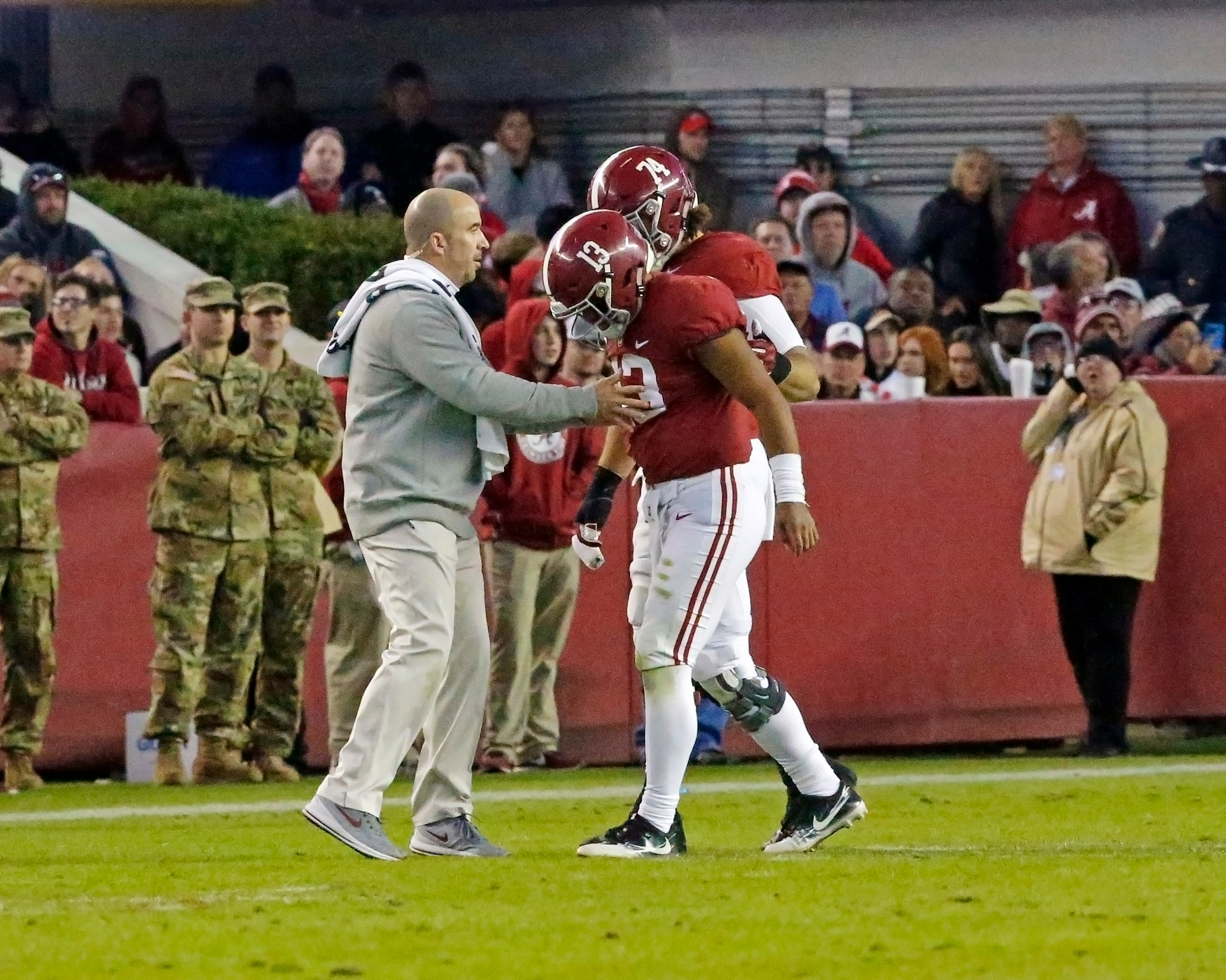 Alabama Crimson Tide offensive lineman Jedrick Wills Jr. (74) helps Alabama Crimson Tide quarterback Tua Tagovailoa (13) off the field in the third quarter during the second half of the game between Mississippi State and the University of Alabama at Bryant-Denny Stadium in Tuscaloosa, Al. Credit: Jason Clark / Daily Mountain Eagle